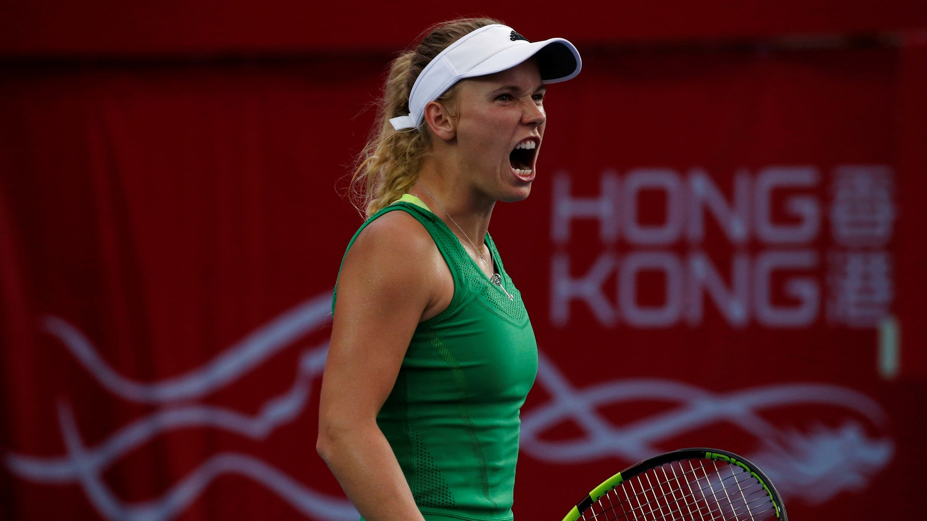 Tennis - Hong Kong Open final - Caroline Wozniacki of Denmark v Kristina Mladenovic of France - Hong Kong, China - 16/10/16. Wozniacki reacts after winning a point.  REUTERS/Bobby Yip - RTX2P0ZW