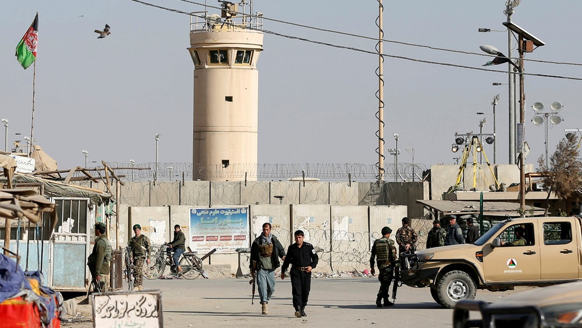 Five U.S. troops were wounded when a suicide bomber drove a car bomb into an armored convoy outside Bagram Air Base.