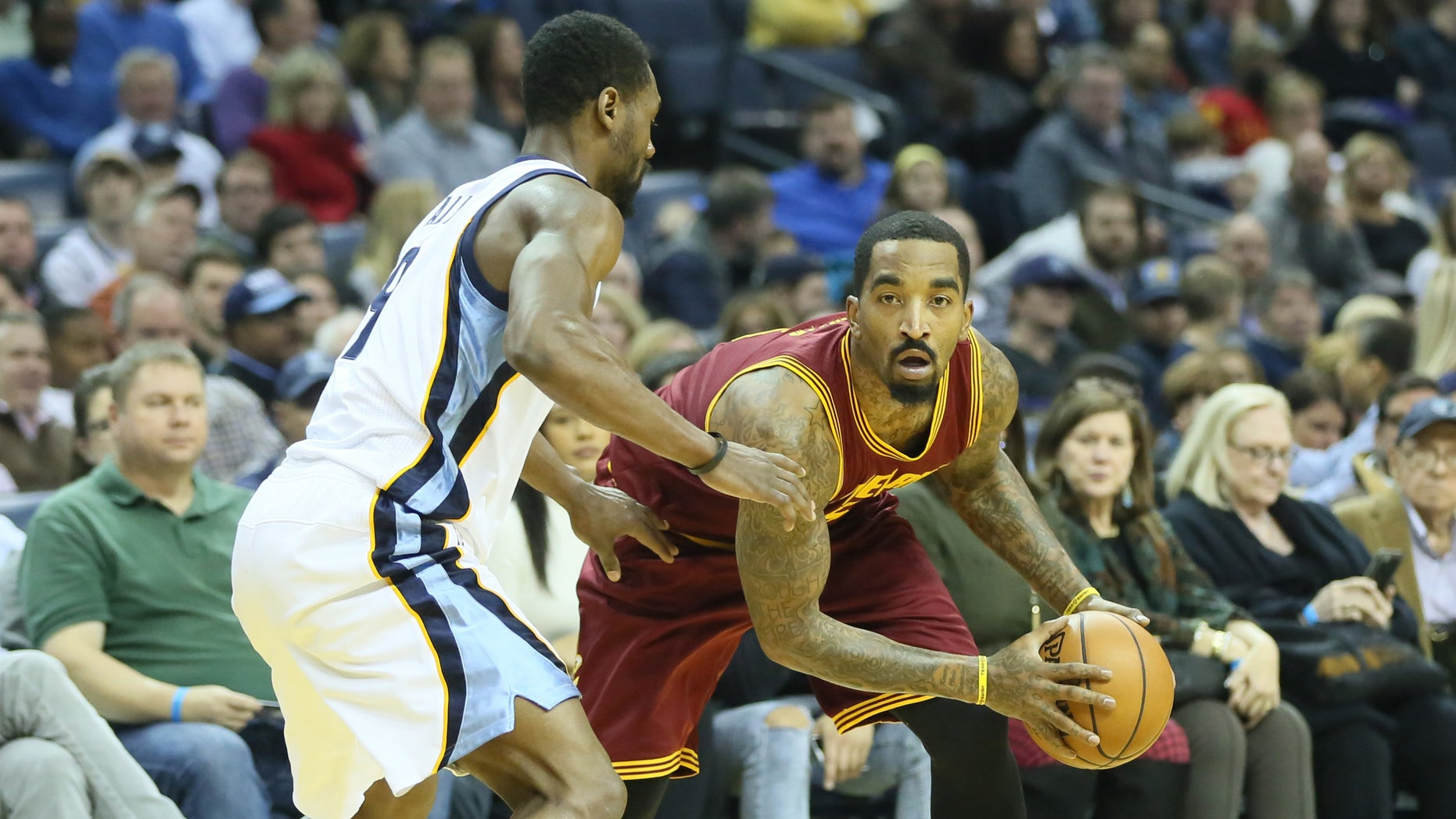 Dec 14, 2016; Memphis, TN, USA; Cleveland Cavaliers guard J.R. Smith (5) holds the ball as Memphis Grizzlies guard Tony Allen (9) defends at FedExForum. Memphis defeated Cleveland 93-85. Mandatory Credit: Nelson Chenault-USA TODAY Sports