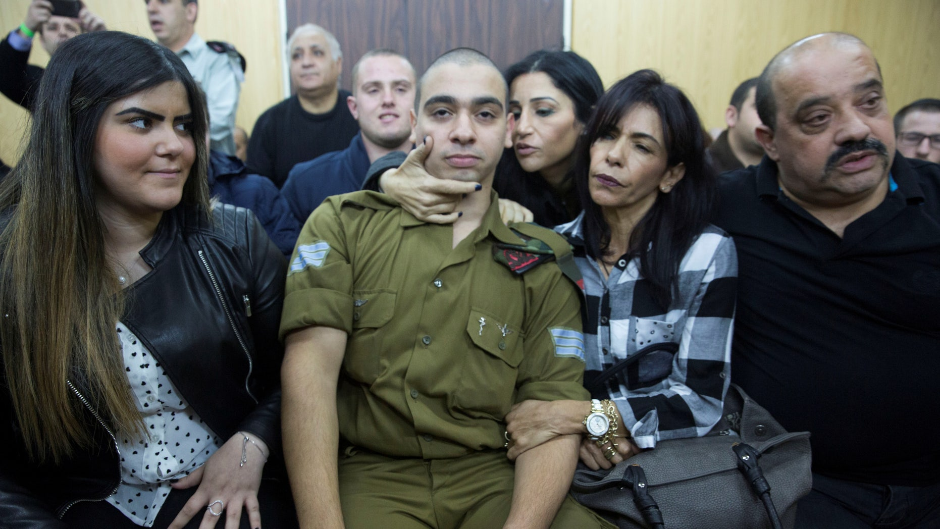 Israeli soldier Elor Azaria, center, sitting to hear the verdict on Wednesday.
