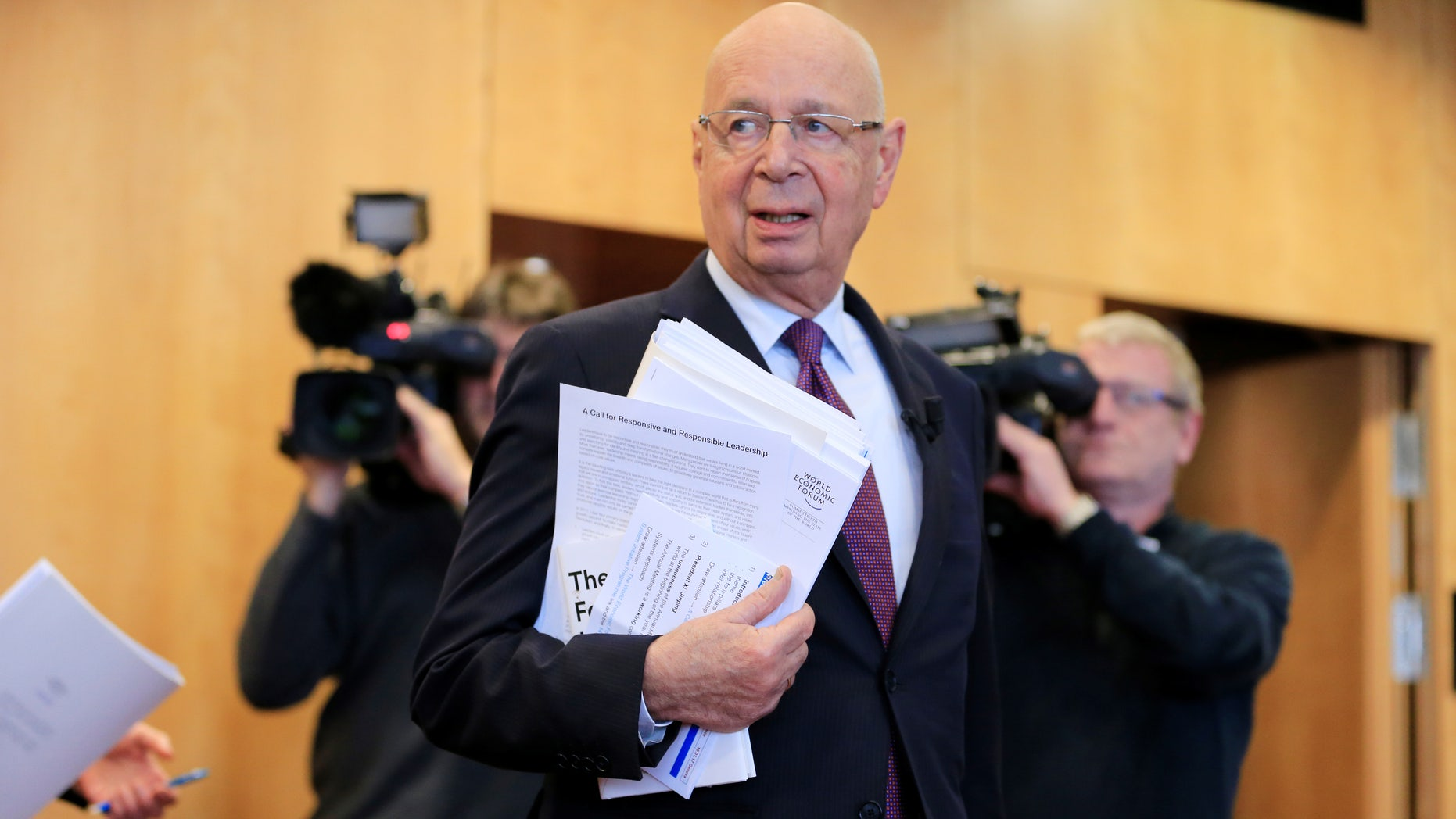 World Economic Forum (WEF) Executive Chairman and founder Klaus Schwab arrives at a news conference in Cologny, near Geneva, Switzerland January 10, 2017.