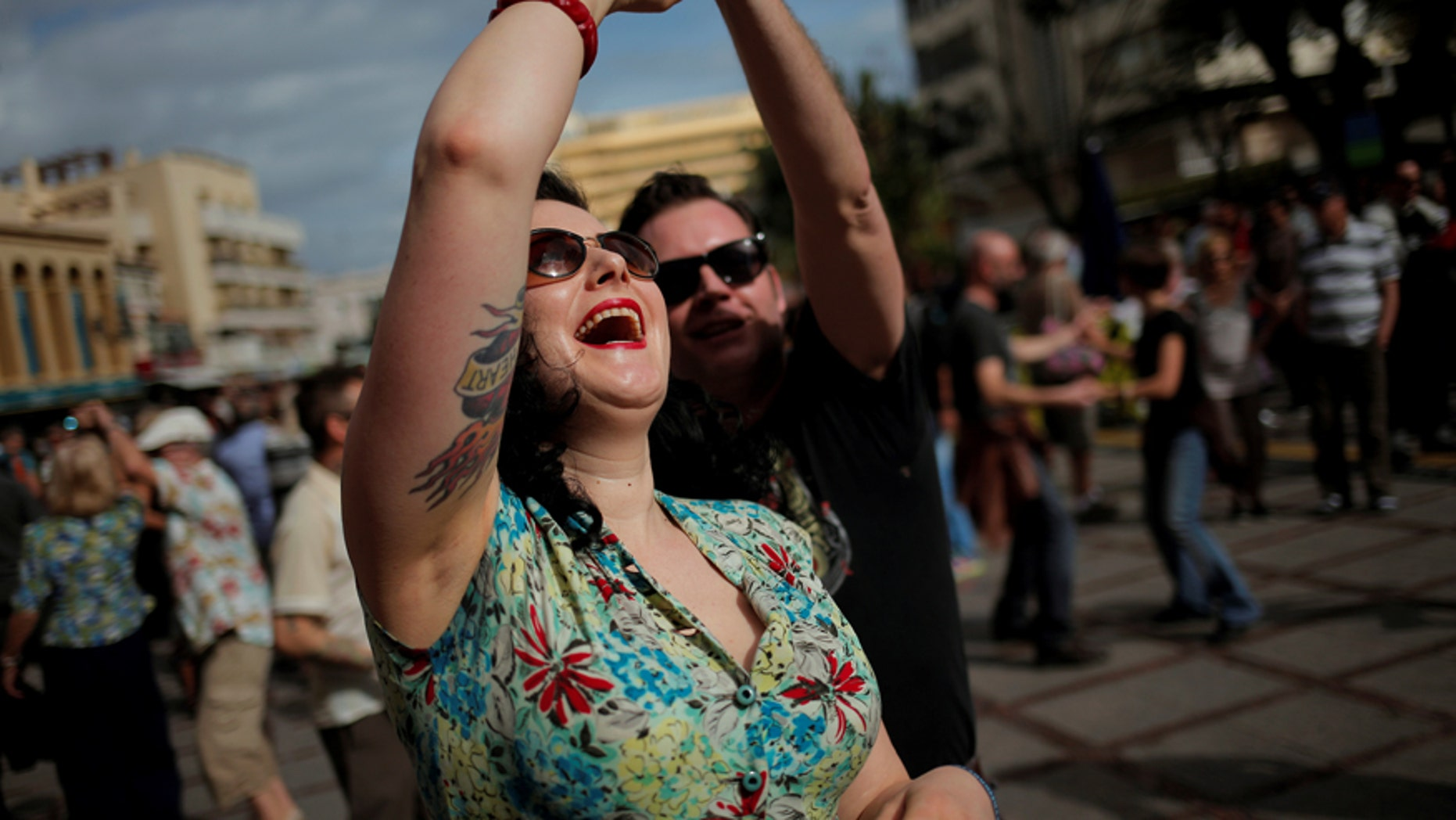People dressed in fifties-style outfits dance during the 23rd Rockin' Race Jamboree International Festival in downtown Torremolinos, near Malaga, southern Spain February 4, 2017. REUTERS/Jon Nazca - RTX2ZN4R