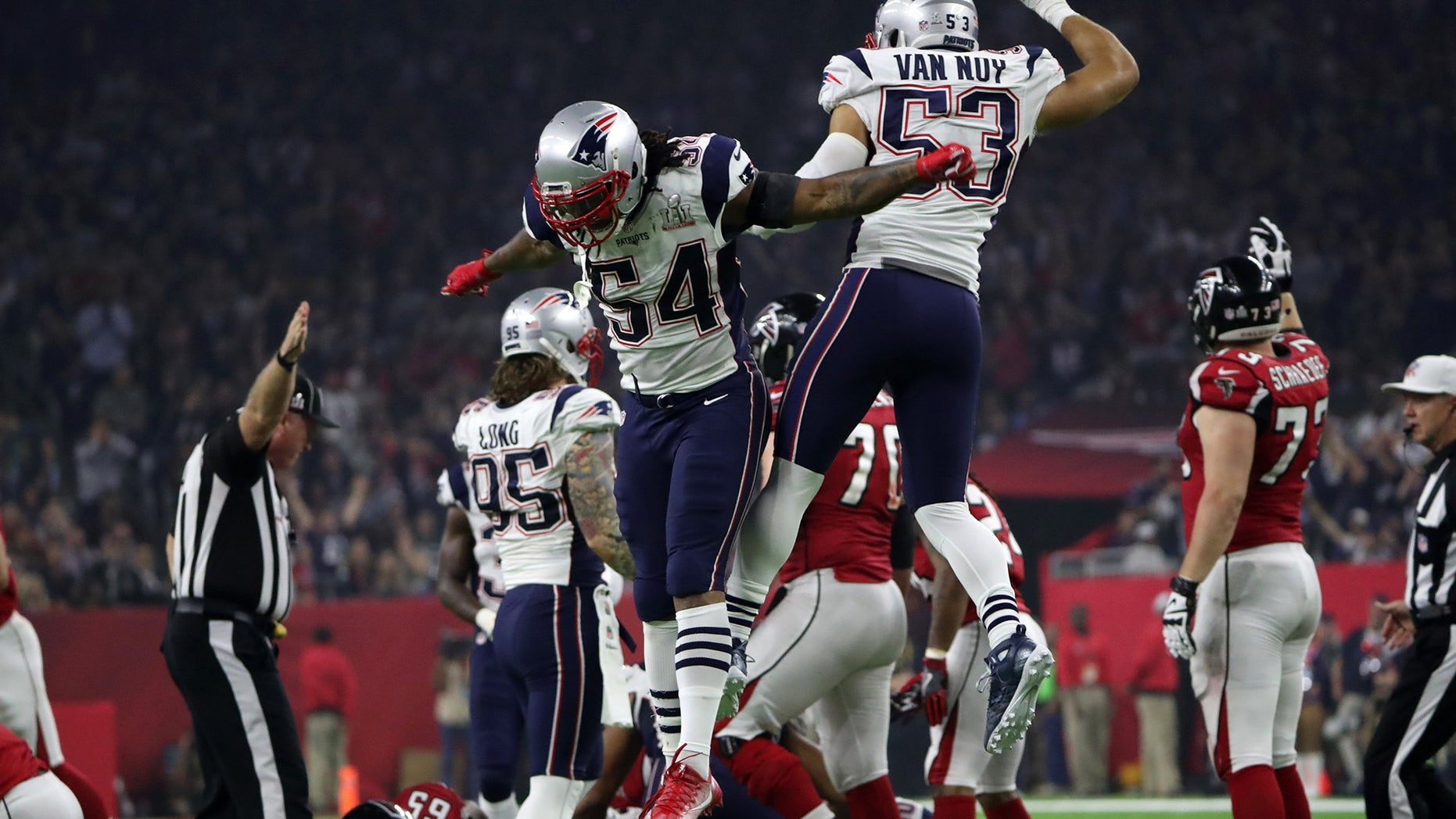 FILE -- February 5, 2017: New England Patriots' Dont'a Hightower (L) and Kyle Van Noy celebrate after New England recovered the ball during the fourth quarter against the Atlanta Falcons at Super Bowl LI in Houston, Texas.