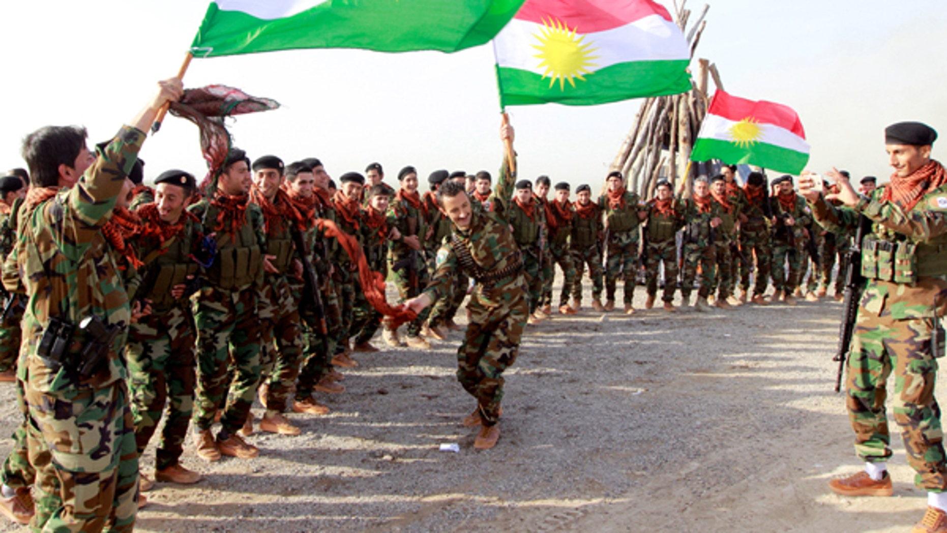 March 20, 2017: Kurdish Peshmerga forces celebrate Newroz Day, a festival marking spring and the new year, in Kirkuk.
