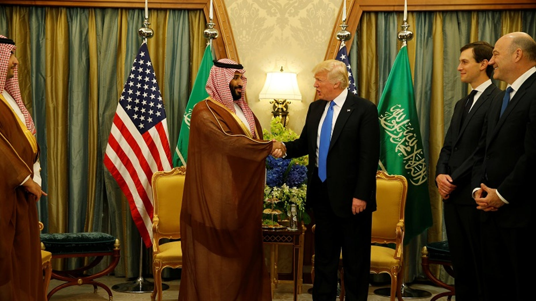 FILE -- President Donald Trump meets with Saudi Arabia's Deputy Crown Prince and Minister of Defense Mohammed bin Salman (center L) at the Ritz Carlton Hotel in Riyadh, Saudi Arabia May 20, 2017.