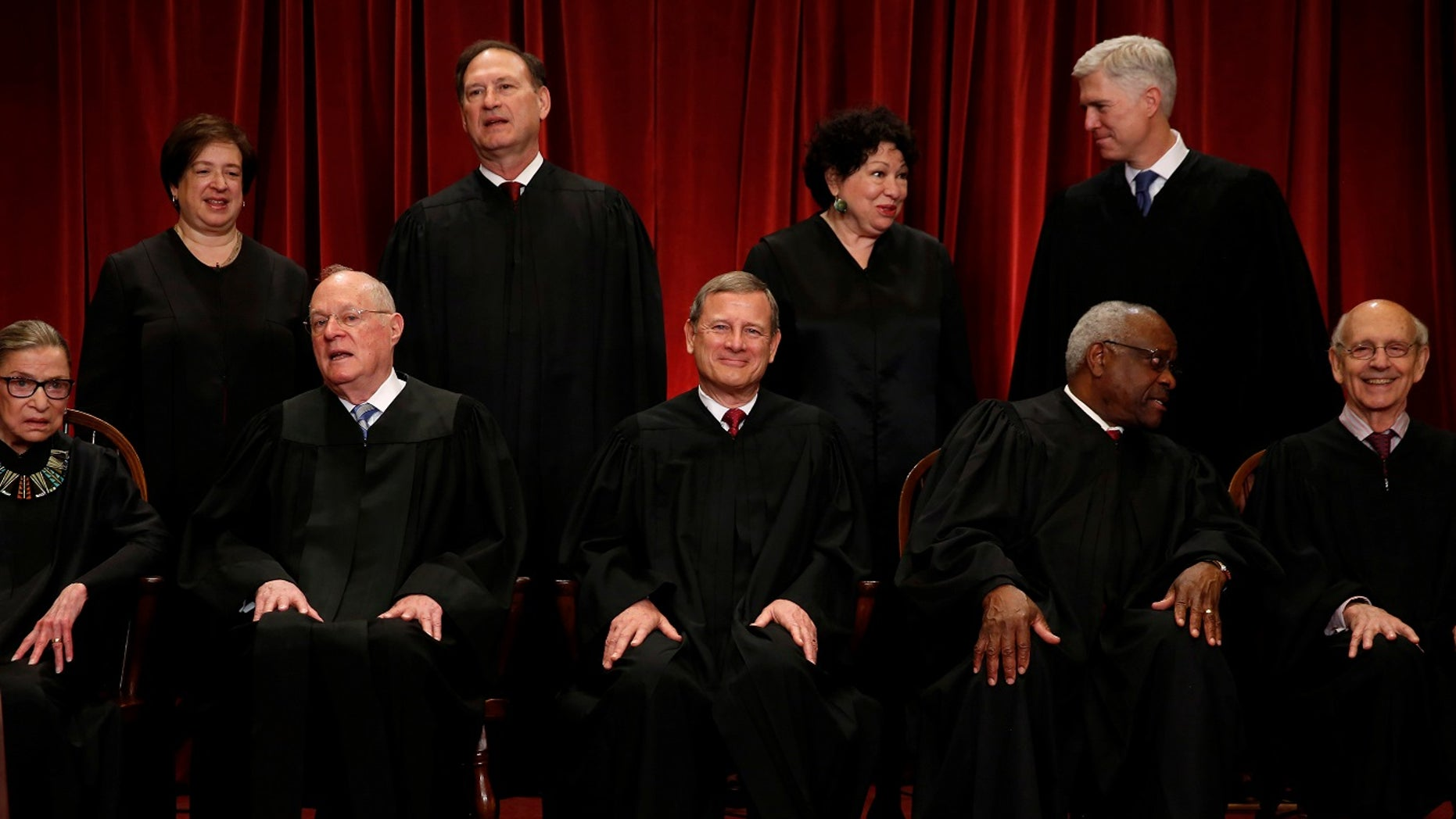 The nine justices of the U.S. Supreme Court. Front row: Ruth Bader Ginsburg, Anthony Kennedy, Chief Justice John Roberts, Clarence Thomas and Stephen Breyer. Back row: Elena Kagan, Samuel Alito, Sonya Sotomayor and Neil Gorsuch.