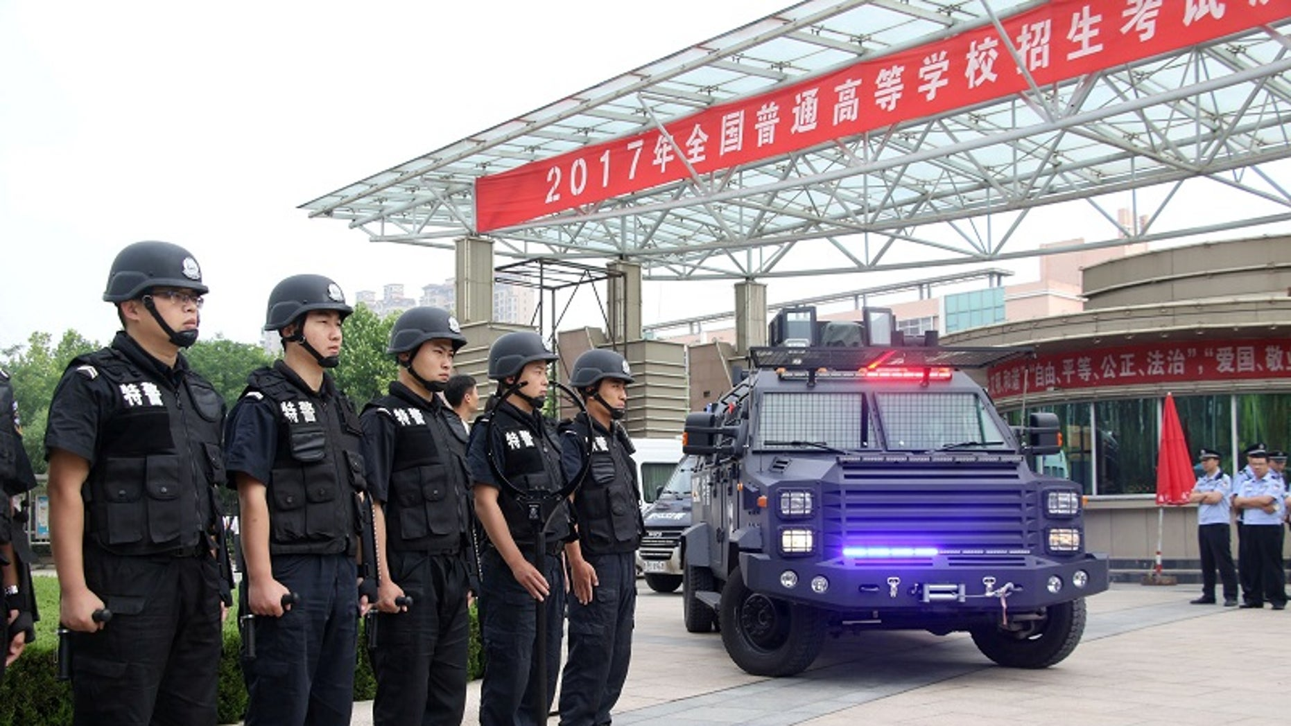 "Special force police officers stand guard outside a high school, on the first day of China's national college entrance exam known as ""gaokao"", in Binzhou, Shandong province, China June 7, 2017."