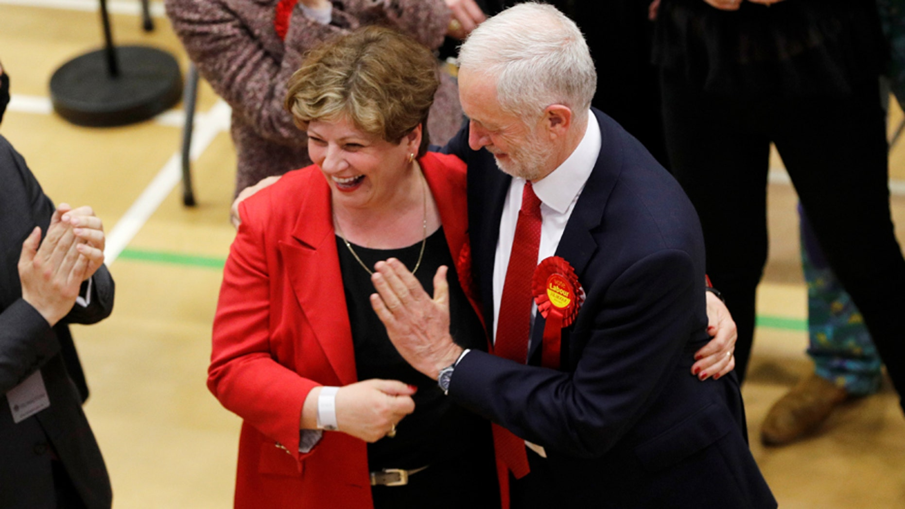Jeremy Corbyn, leader of Britain's Labour Party tries to exchange a high five with Shadow Foreign Secretary Emily Thornberry at Britain's general election counting centre in Islington, London, June 9, 2017. REUTERS/Darren Staples - RTX39RN5
