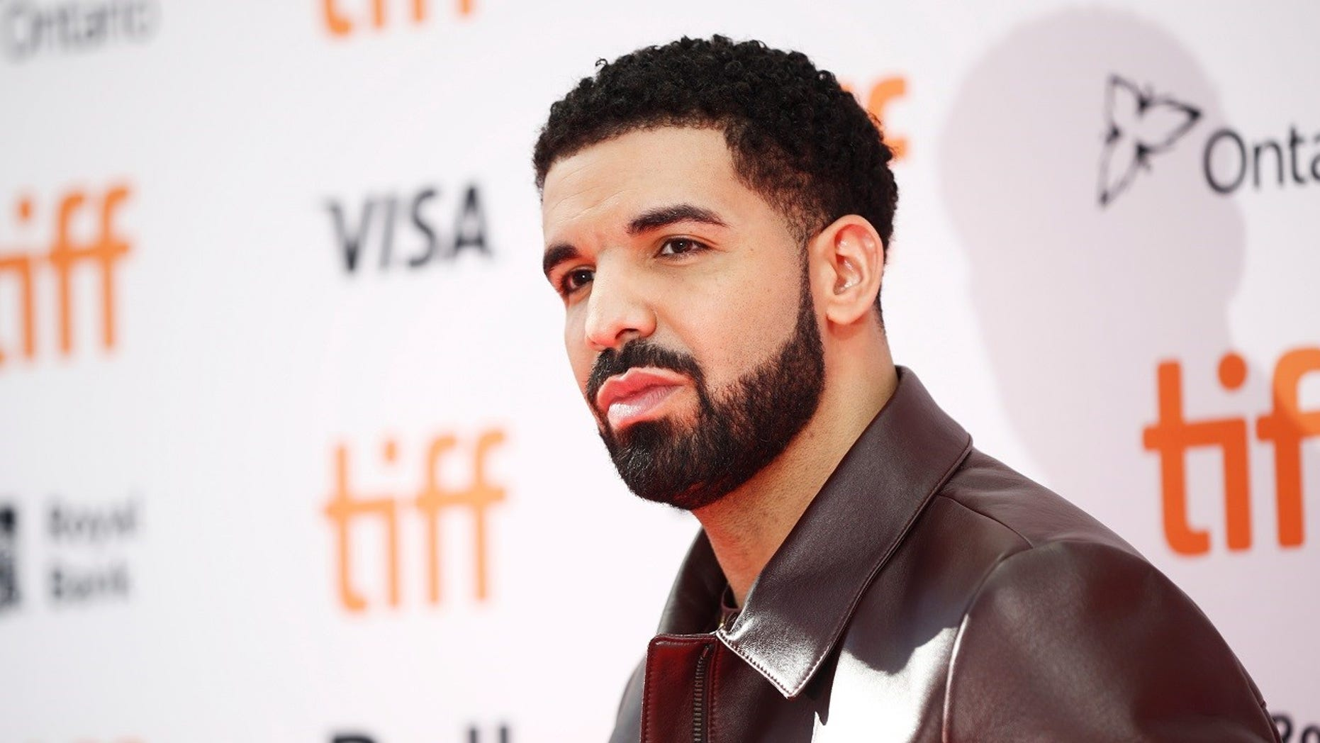 "Drake reportedly gave more than $125,000 to students and shoppers while filming the music video for ""God's Plan."""