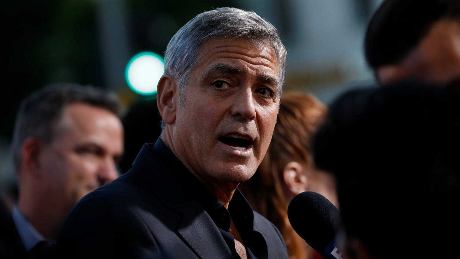 """George Clooney said he hopes the sexual harassment stories after the Harvey Weinstein scandal will be a """"watershed moment for society."""""""