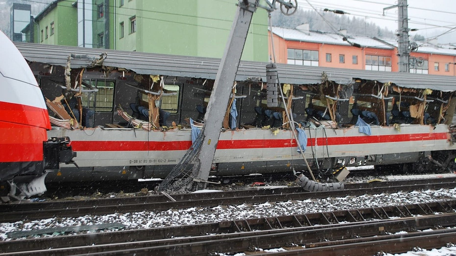 One woman was killed and 22 others were injured after two passenger trains collided in Austria.