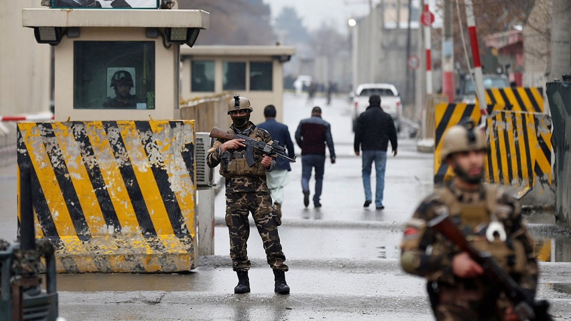 Security forces guard the site of a suicide bombing in the diplomatic area of Kabul, Afghanistan, Saturday Feb. 24, 2018, near the US Embassy and NATO HQ.