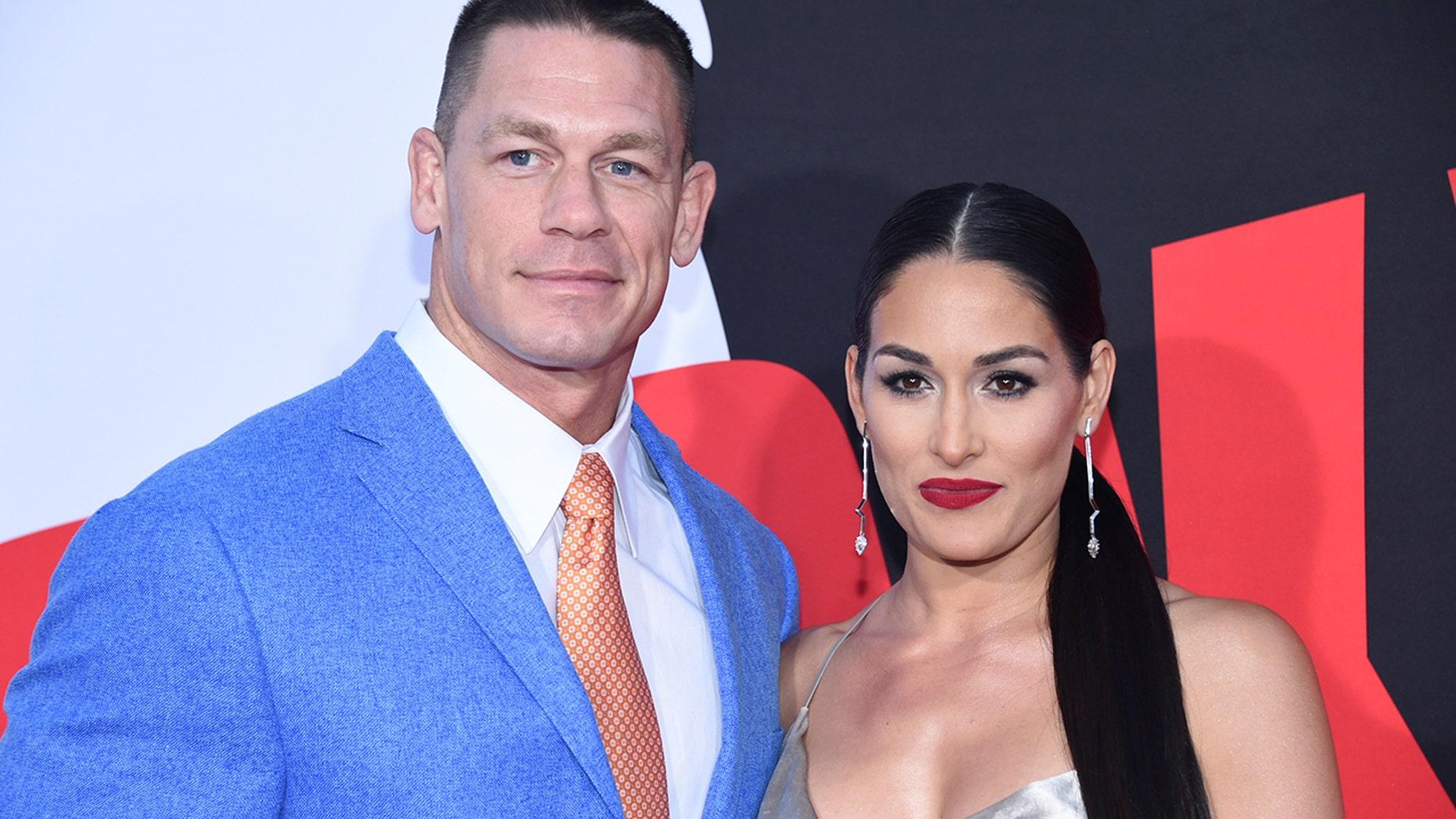 "Cast member John Cena (L) and Nikki Bella attend the premiere of ""Blockers"" in Los Angeles, California, U.S. April 3, 2018. REUTERS/Phil McCarten - RC1DBF93F9A0"