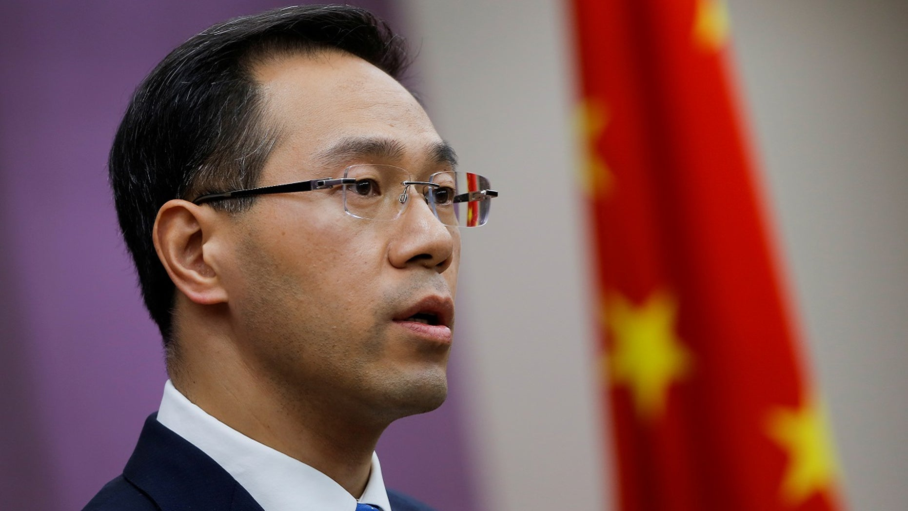Gao Feng, a spokesman for China's Ministry of Commerce, addresses reporters in Beijing, April 6, 2018.