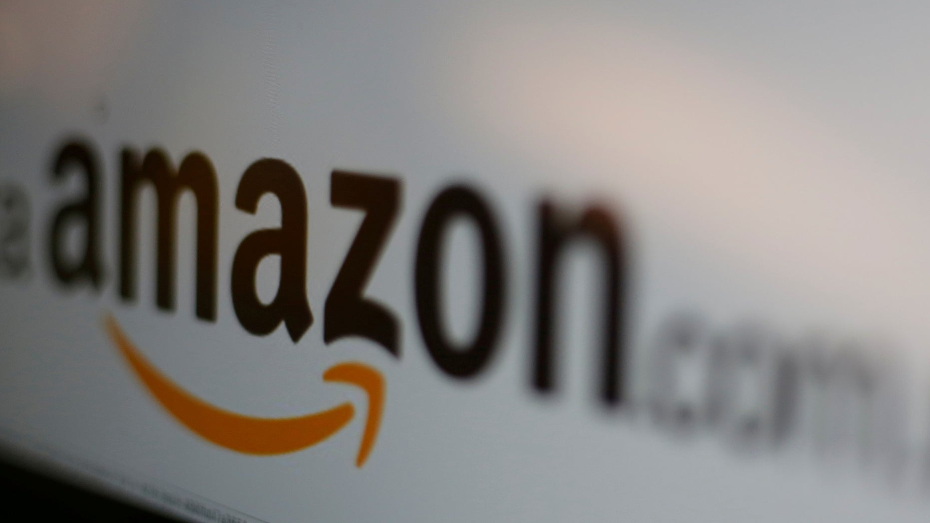 FILE PICTURE - The logo of the web service Amazon is pictured in this June 8, 2017 illustration photo. (REUTERS/Carlos Jasso)