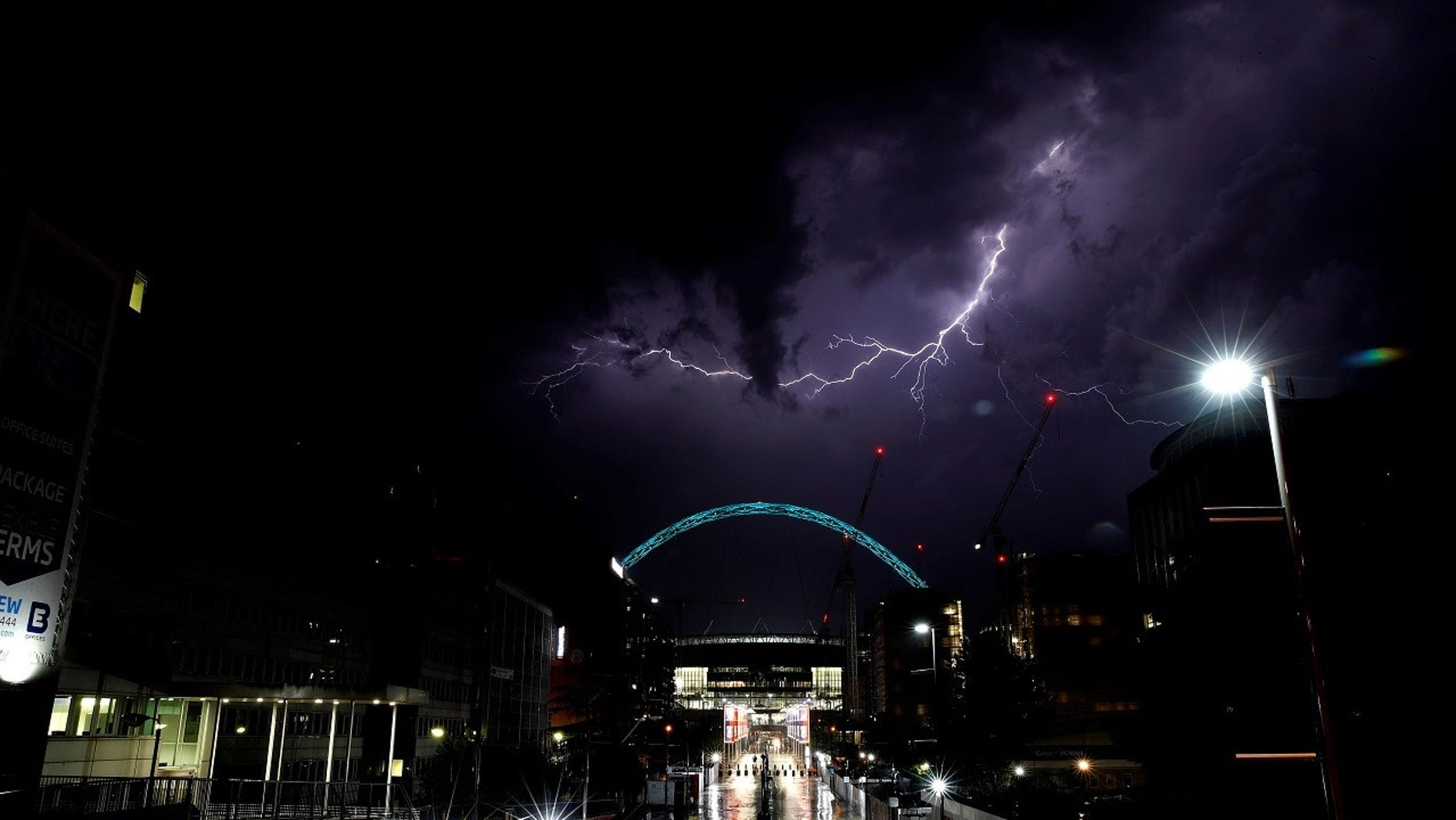 Lightning strikes above Wembley Stadium in London.