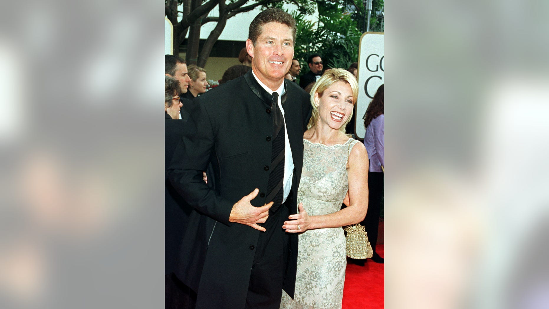 """""""Baywatch"""" star David Hasselhoff and his wife Pamela Bach arrive at the 55th annual Golden Globe Awards in Beverly Hills, January 18. The Golden Globe Awards, sponsored by the Hollywood Foreign Press Association, honors excellence in film and television. - RTXIM7B"""