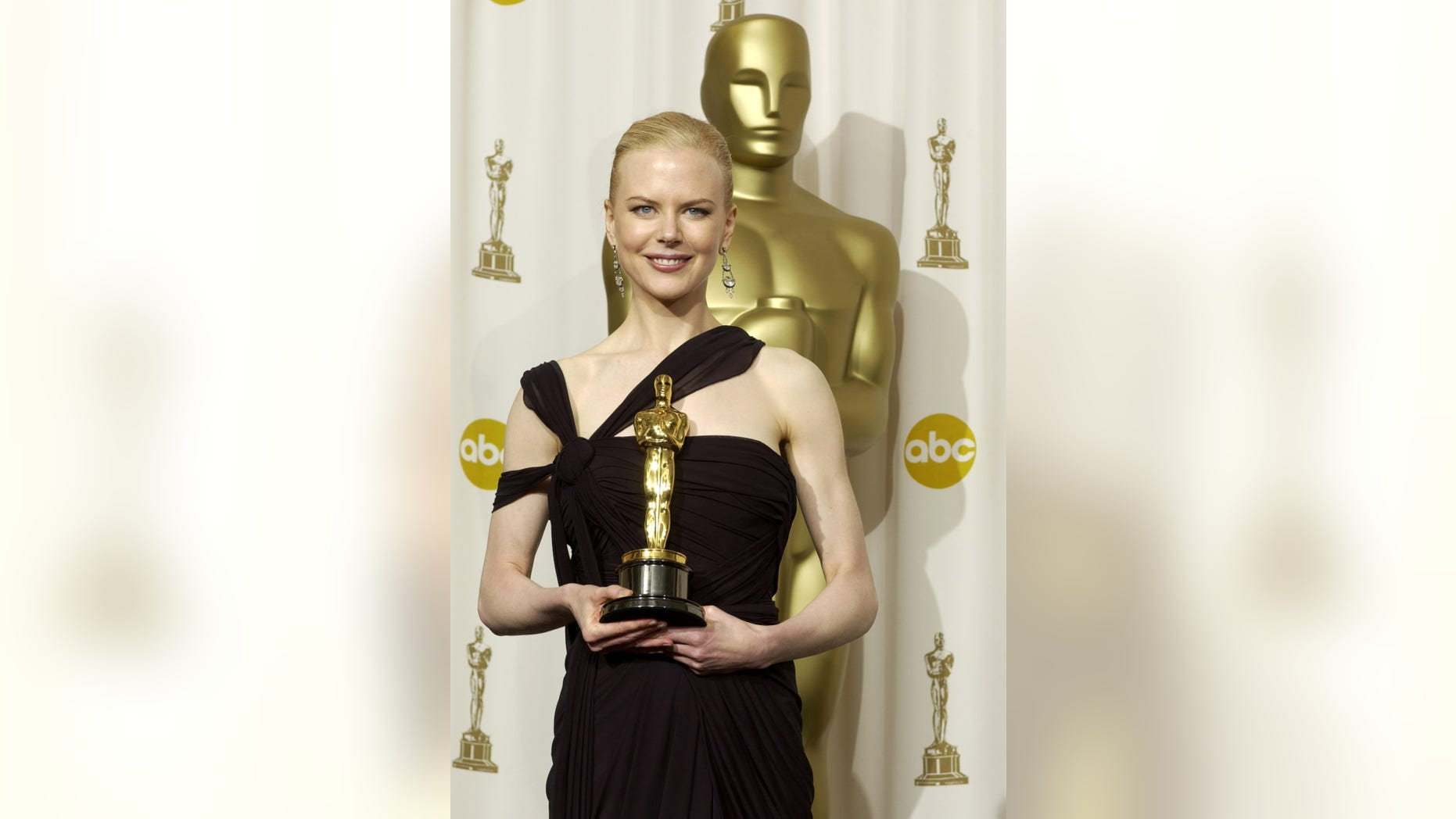 "Nicole Kidman poses with her Oscar statue for the Academy Award for best actress she won for her role in ""The Hours"" at the 75th annual Academy Awards at the Kodak Theatre in Hollywood, March 23, 2003."