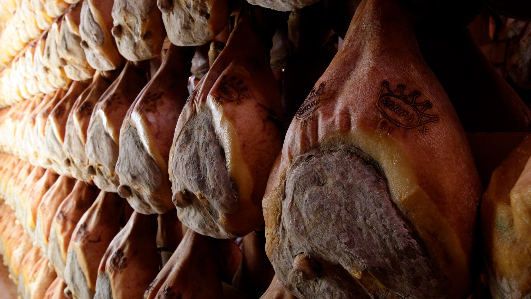 A line of hams hang to dry. (Reuters)