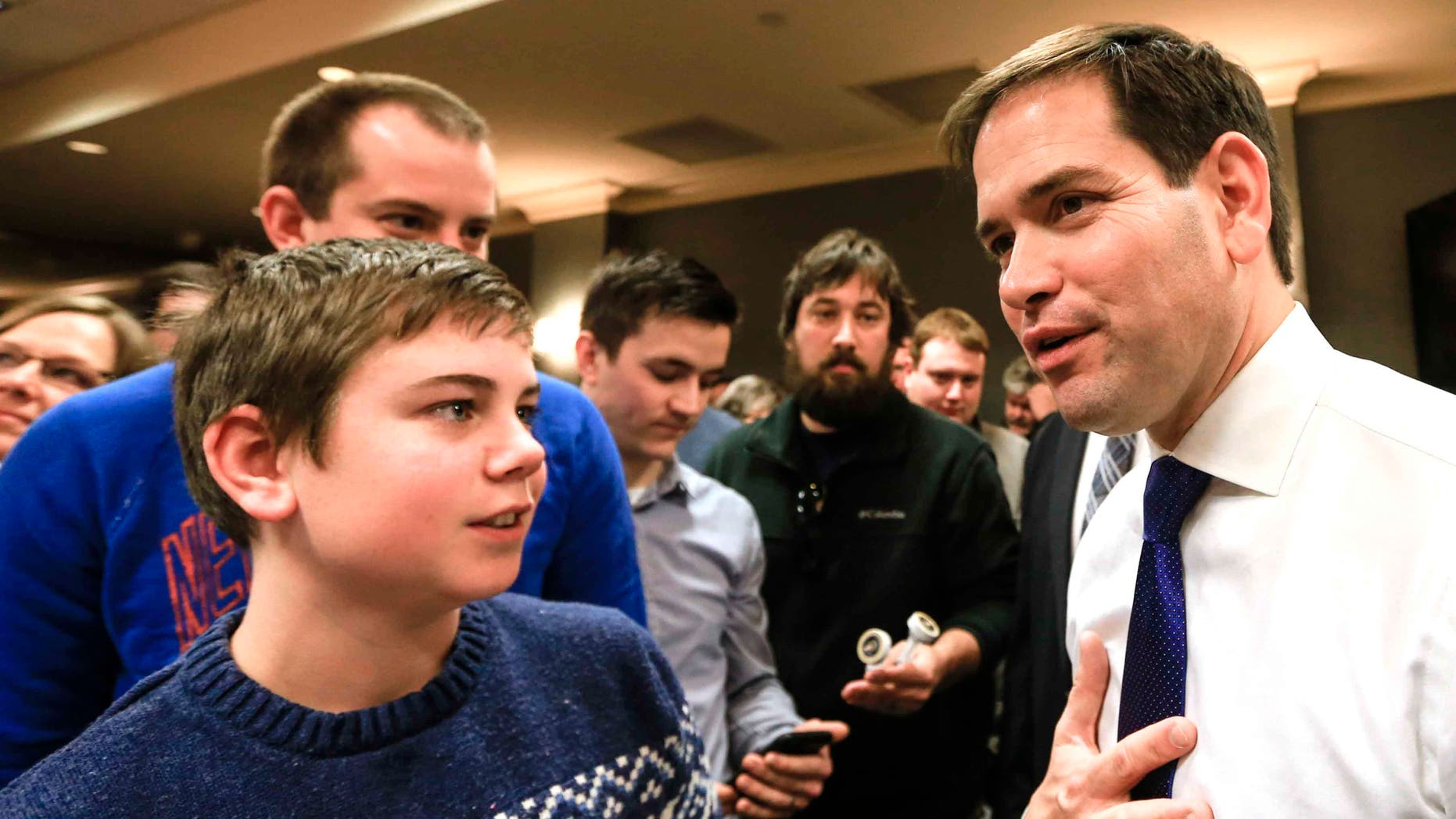 Rubio talks to members of the audience following a campaign stop in Iowa, Sat. Jan. 16, 2016.
