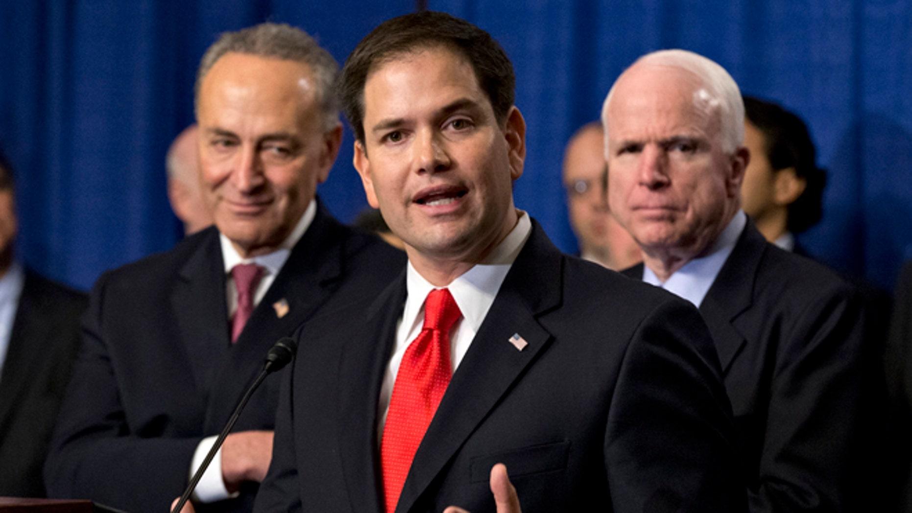 April 18, 2013: Sen. Marco Rubio, R-Fla., flanked by Sen. Charles Schumer, D-N.Y., left, and Sen. John McCain, R-Ariz., right, speaks about immigration legislation.