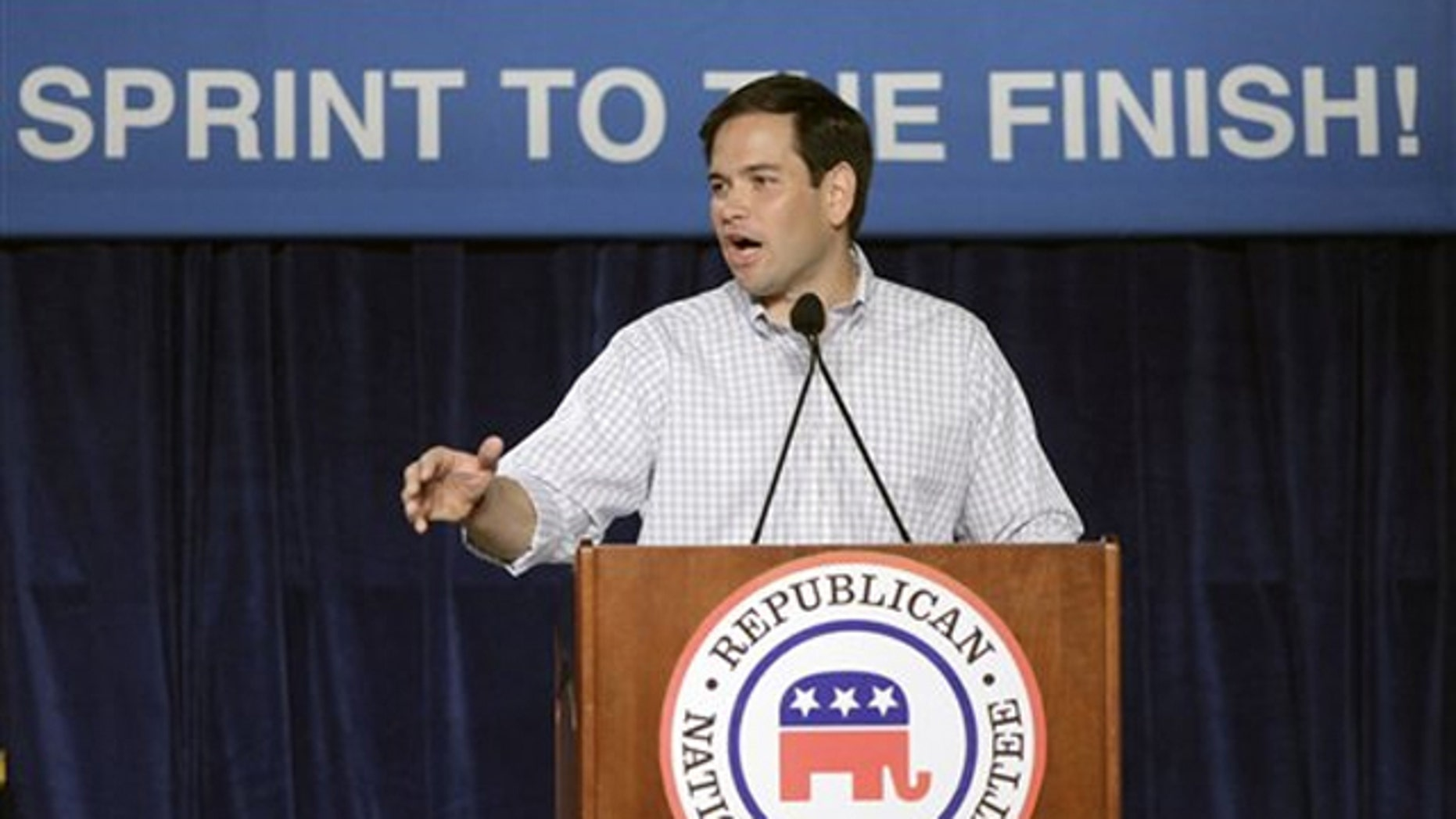 In this file photo, then-Senate candidate Marco Rubio speaks to supporters during a Republican National Committee rally in Orlando Oct. 23, 2010.