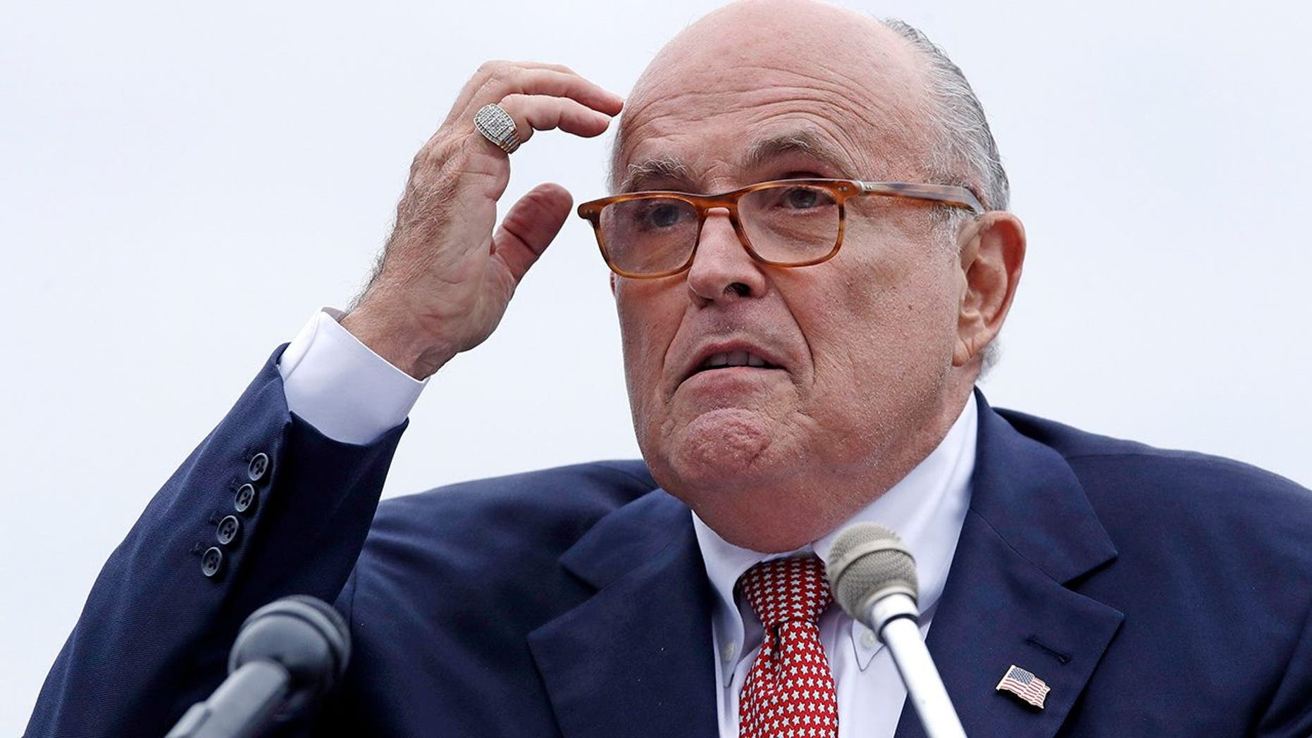 FILE - In this Aug. 1, 2018 file photo, Rudy Giuliani, an attorney for President Donald Trump, addresses a gathering during a campaign event for Eddie Edwards, who is running for the U.S. Congress, in Portsmouth, N.H. President Donald Trump will not answer any questions, written or in-person, about possible obstruction of justice, Giuliani told The Associated Press. Giuliani's statement was the most definitive rejection yet of Special Counsel Robert Mueller's efforts to interview the president about any efforts to block the investigation into possible coordination between his campaign and Russians. (AP Photo/Charles Krupa, File )<br>