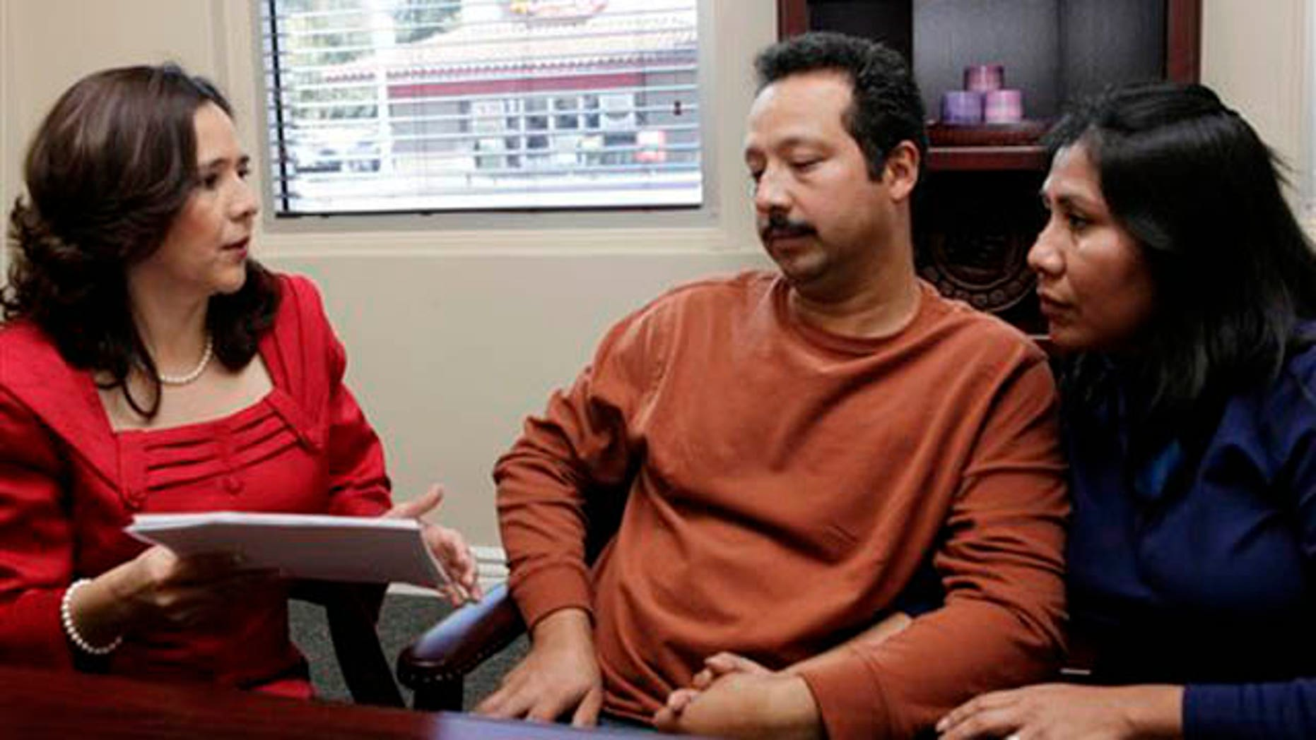 Jan. 6, 2012: Attorney Jessica Dominguez, left  speaks with Jose Luis Barajas and his wife, Laura Barajas at Dominguez' office in Los Angeles.