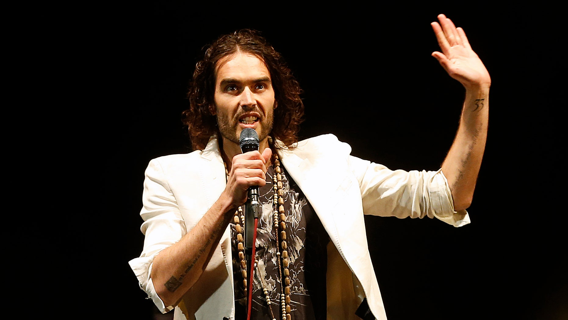 March 9, 2014. British comedian Russell Brand performs at his Messiah Complex show at Brixton Academy in London.