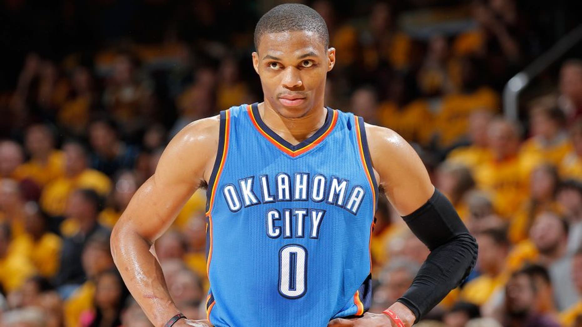 CLEVELAND, OH - JANUARY 25: Russell Westbrook #0 of the Oklahoma City Thunder looks on during the game against the Cleveland Cavaliers on January 25, 2015 at Quicken Loans Arena in Cleveland, Ohio. NOTE TO USER: User expressly acknowledges and agrees that, by downloading and or using this Photograph, user is consenting to the terms and condition of the Getty Images License Agreement. (Photo by Rocky Widner/Getty Images)