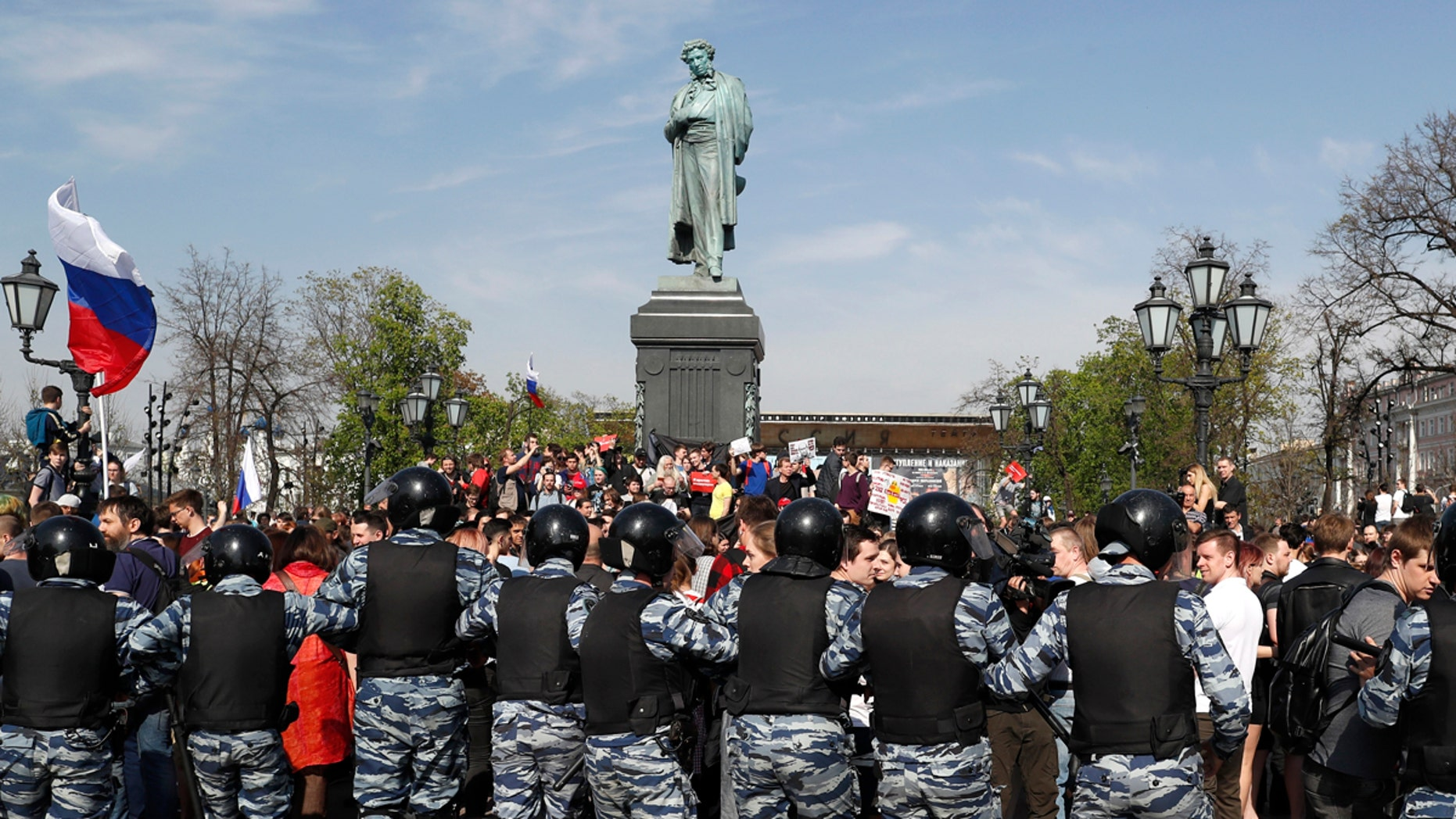 Russian police push protesters back during a demonstration against President Vladimir Putin in Pushkin Square in Moscow, Russia, Saturday, May 5, 2018.