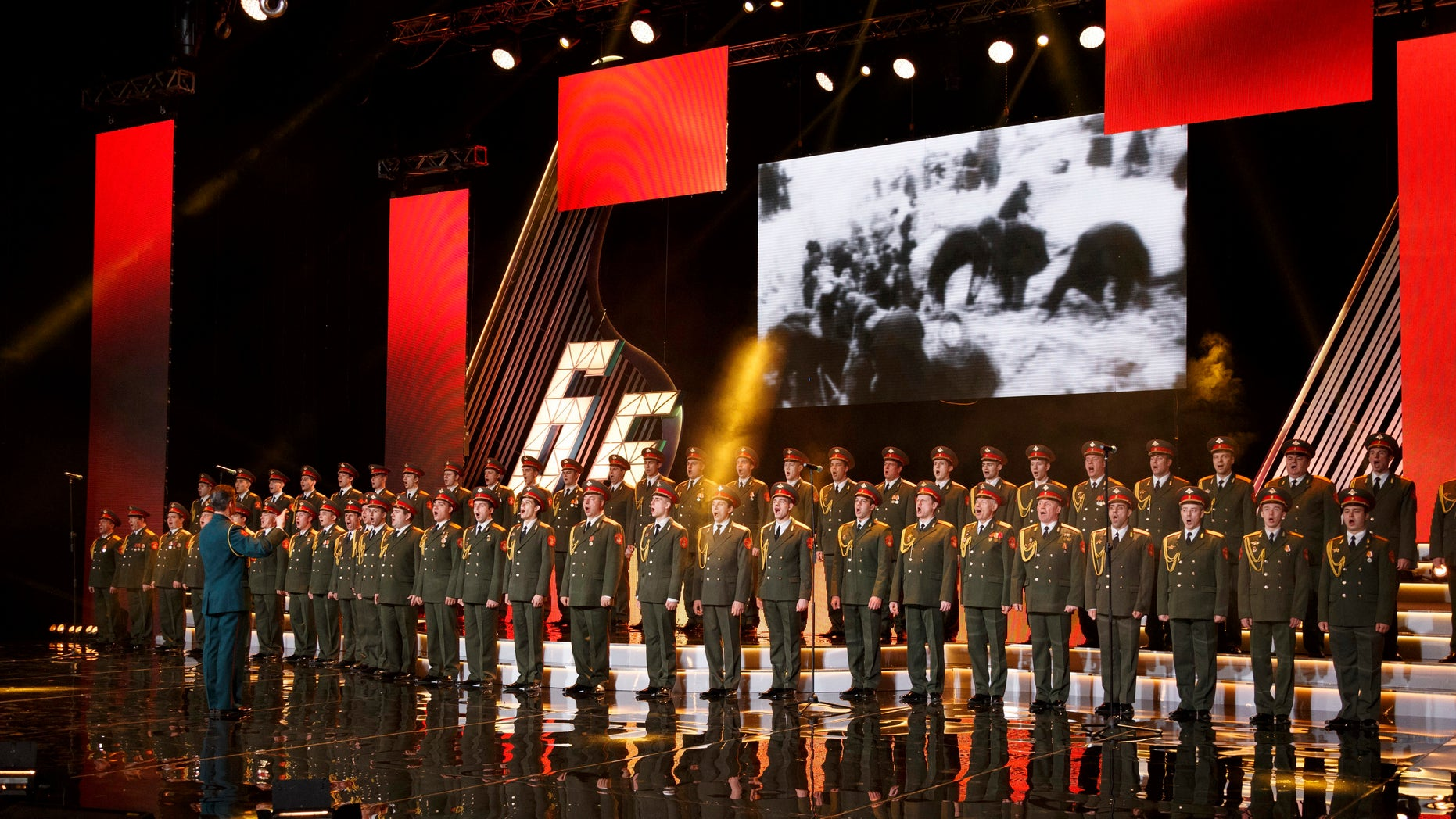 In this photo taken on Thursday, March 31, 2016, the Alexandrov Ensemble choir performs during a concert in Moscow, Russia. A Russian plane with 92 people aboard, including the well-known military band, crashed into the Black Sea on its way to Syria on Sunday, Dec. 25, minutes after takeoff from the resort city of Sochi, the Defense Ministry said. The Tu-154, which belonged to the ministry, was taking the Alexandrov Ensemble to a concert at the Russian air base in Syria. (AP Photo)
