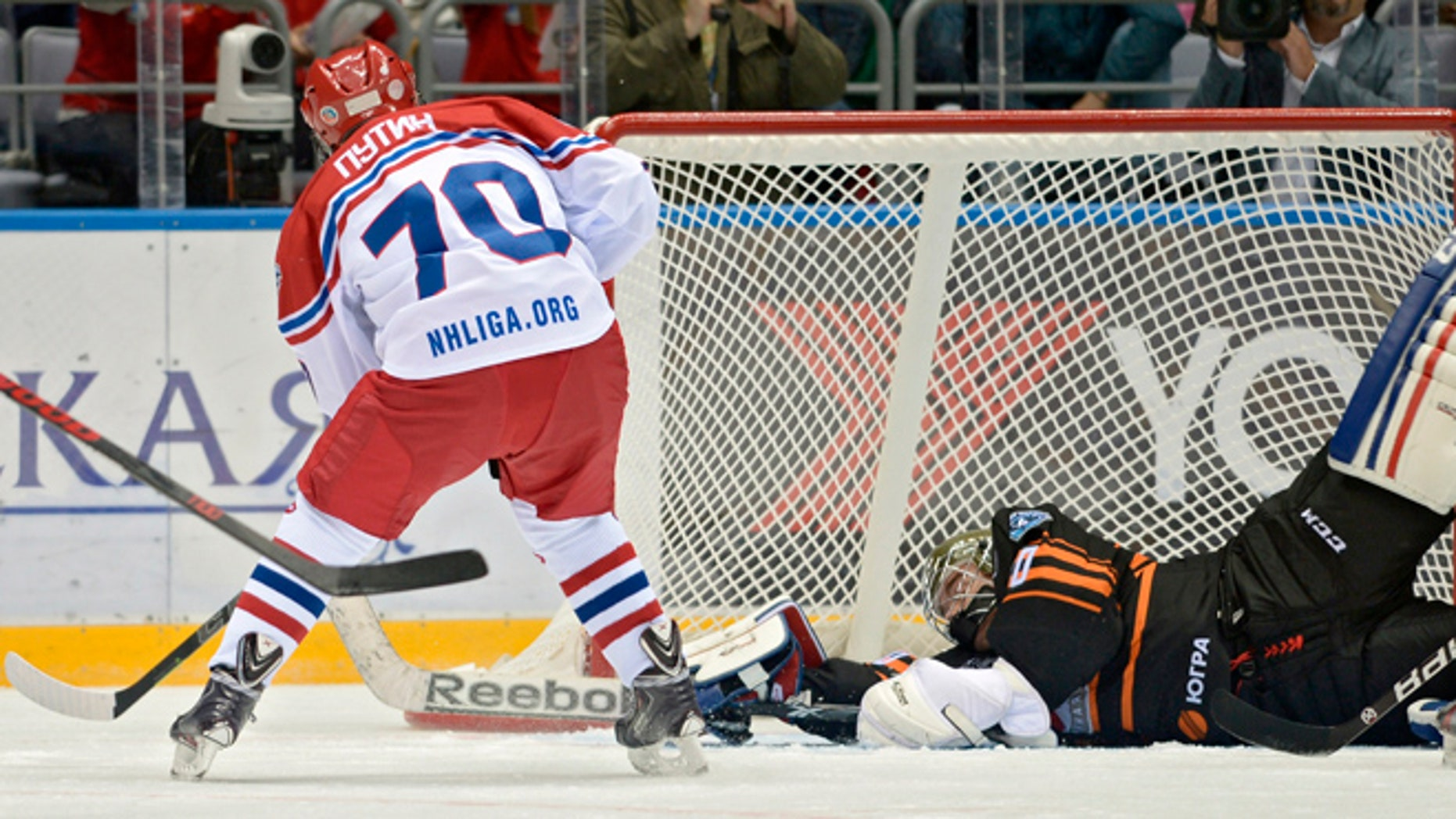May 16, 2015: Russian President Vladimir Putin, back to a camera, scores during an exhibition hockey game at the Night Hockey League tournament in the Black Sea resort of Sochi, Russia. President Vladimir Putin has played in an exhibition hockey game and scored one goal after another on assists from retired NHL players.