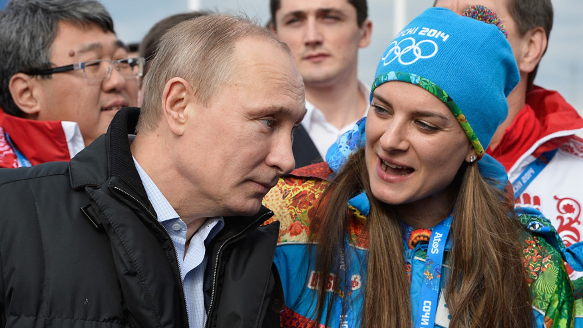 In this Feb. 5, 2014 file photo Russian President Vladimir Putin speaks with Olympic Village Mayor Elena Isinbaeva while visiting the Coastal Cluster Olympic Village ahead of the Sochi 2014 Winter Olympics in Sochi, Russia.