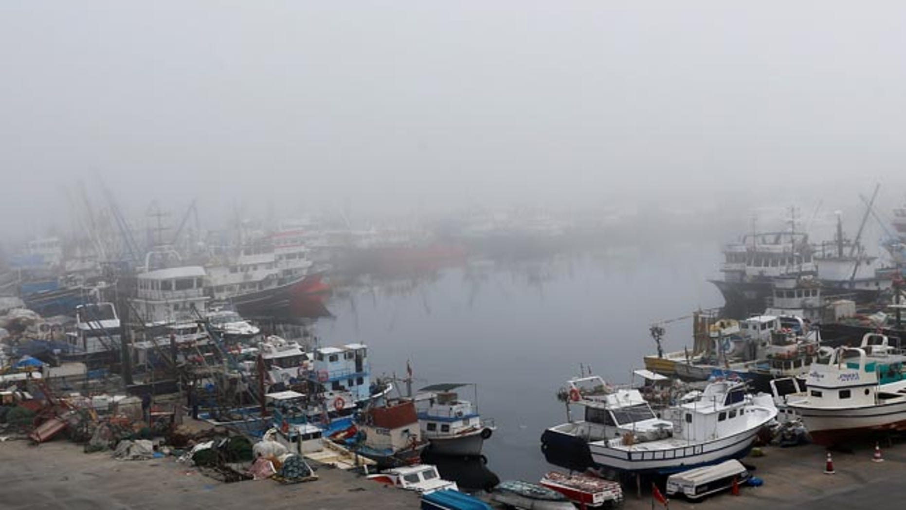 Boats seen in the fog-covered Rumelifeneri village port at the Black Sea on Thursday, the same day a Russian ship sank off the coast.