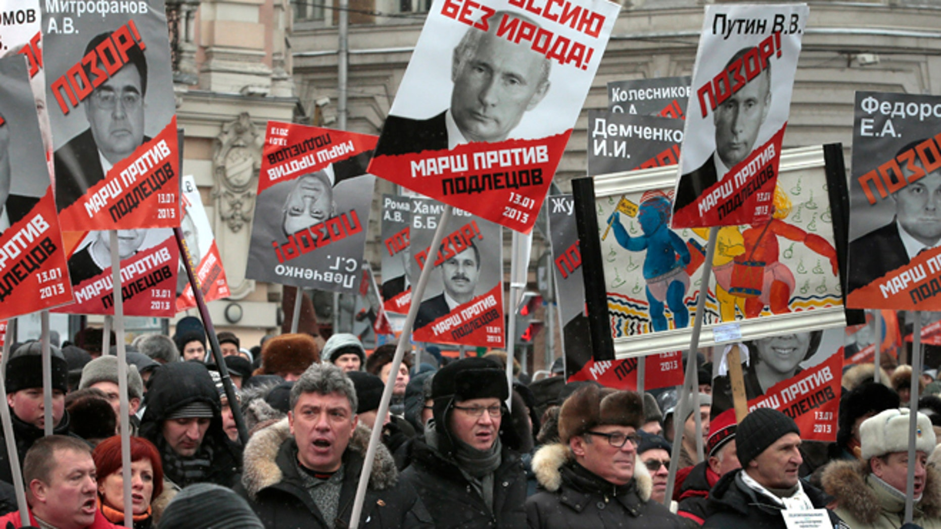 """Some thousands of people are gathering in central Moscow for a protest against Russia's new law banning Americans from adopting Russian children, carrying posters of President Vladimir Putin and members of Russia's parliament who overwhelmingly voted for the law last month, with the word """"Shame"""" written in red over the faces."""