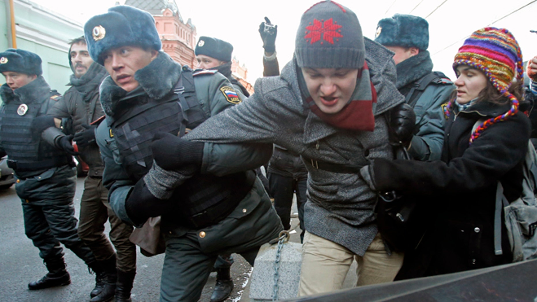 Dec. 19, 2012: In this Wednesday file photo police officers detain gay right activists during a protest near the State Duma, Russia's lower house of parliament, in Moscow, Russia.