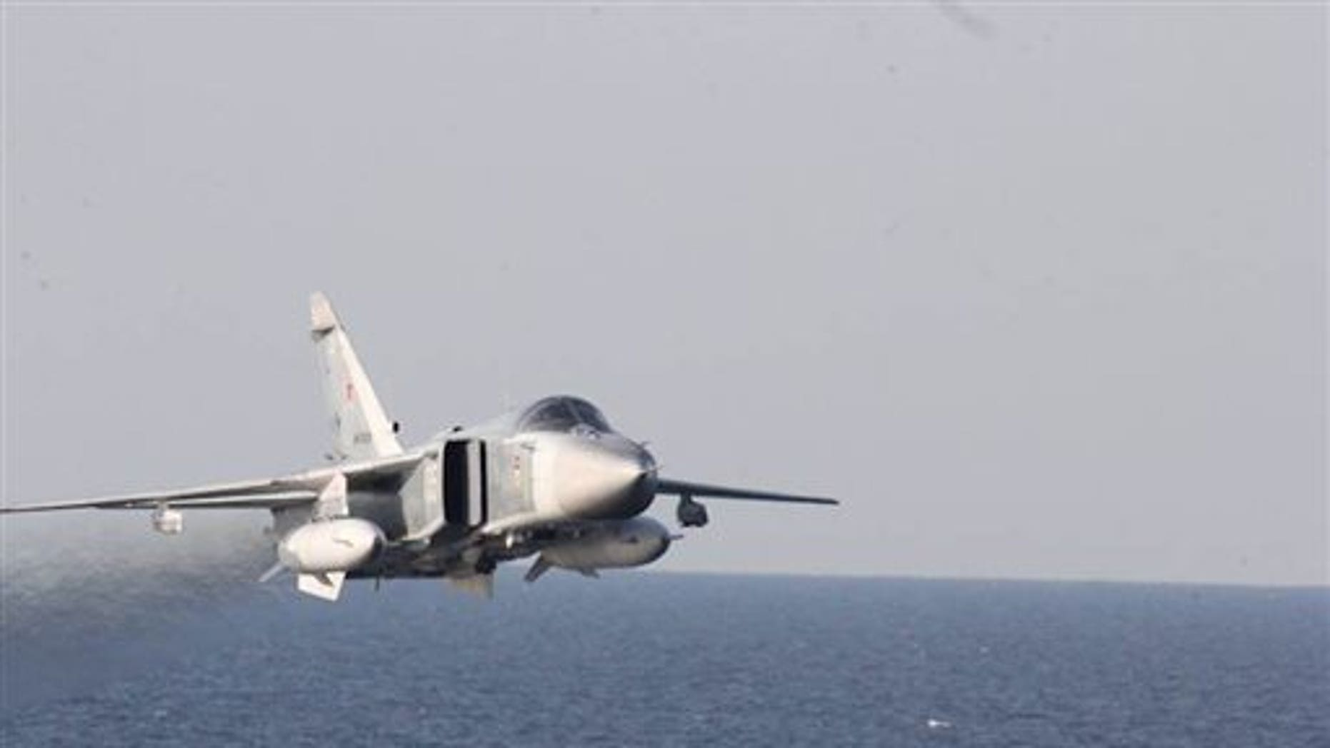 A Russian fighter jet makes a low altitude pass by the USS Donald Cook on April 12.