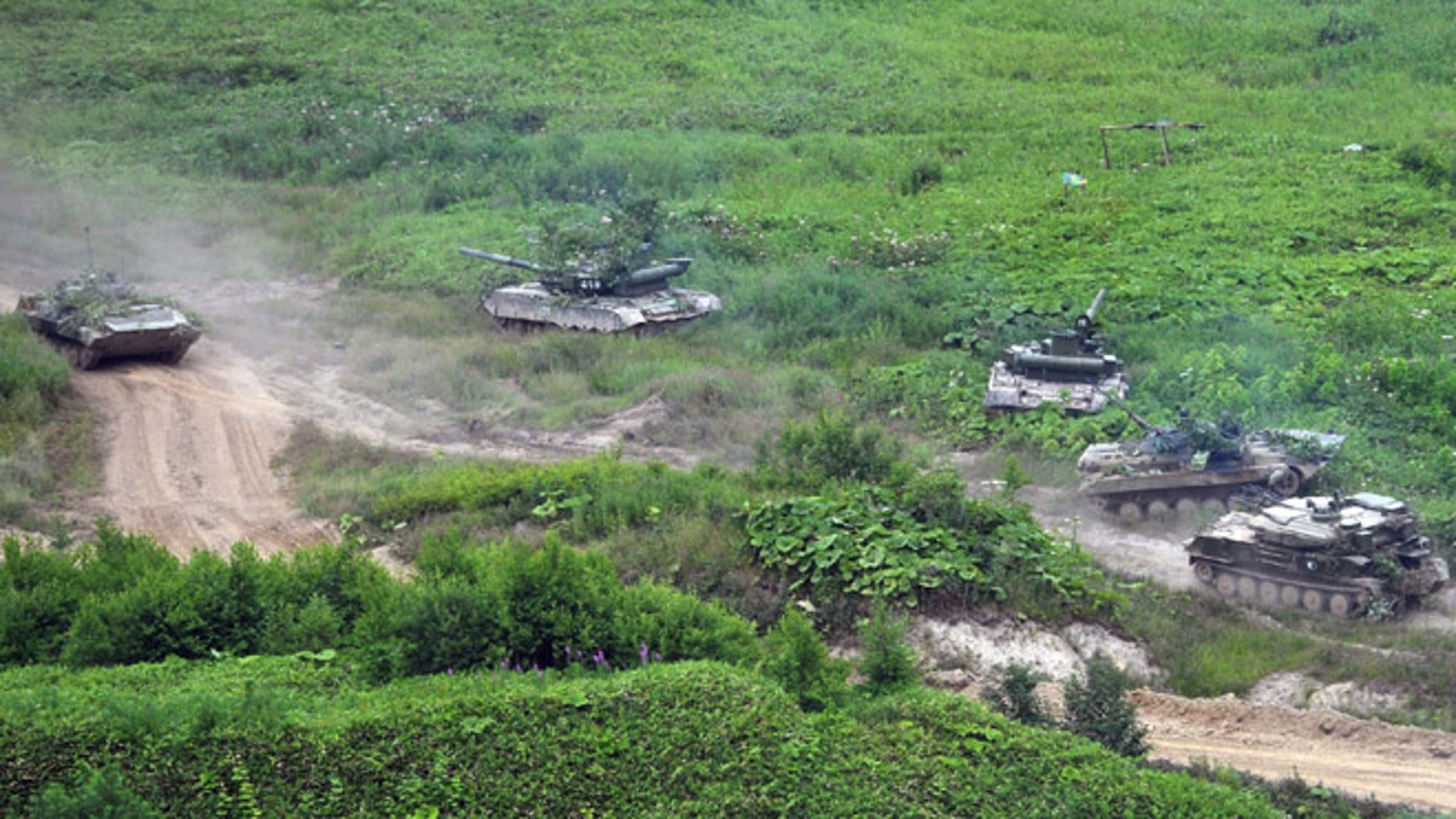 July 16, 2013: Russian Army tanks move at the Sakhalin Island during military exercises. The maneuvers in Siberia and the far eastern region involved 160,000 troops and about 5,000 tanks -- a massive show of force unprecedented since the Soviet times.