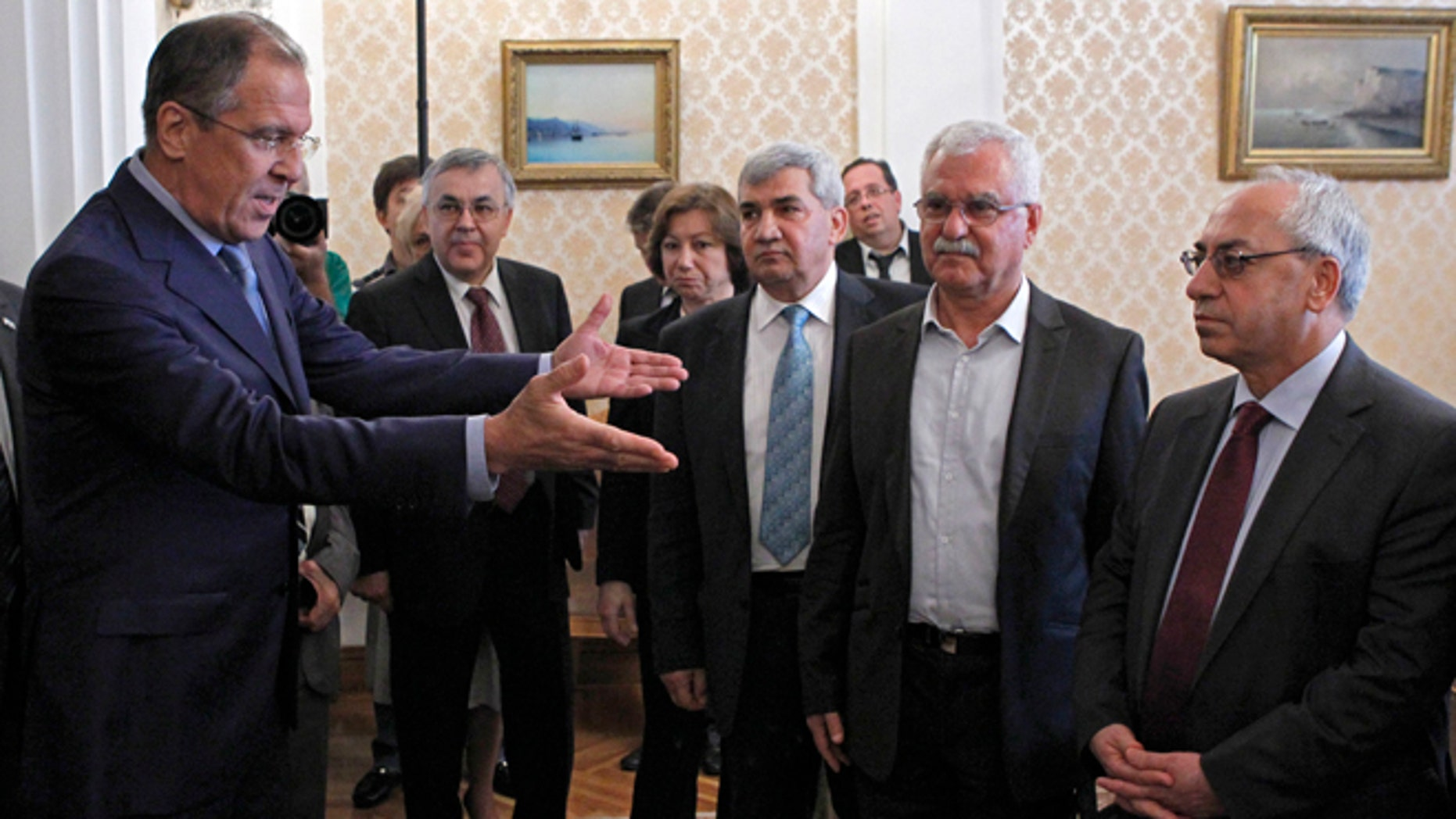 July 11, 2012: Russian Foreign Minister Sergey Lavrov, left, welcomes a delegation headed by a leader of the Syrian National Council (SNC), Abdulbaset Sieda, right, in Moscow, Russia.