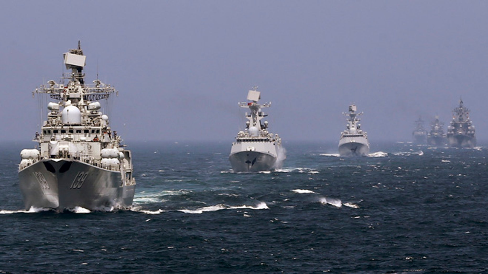 May 24, 2014:Chinese and Russian naval vessels participate in the Joint Sea-2014 naval drill outside Shanghai on the East China Sea. (Reuters)