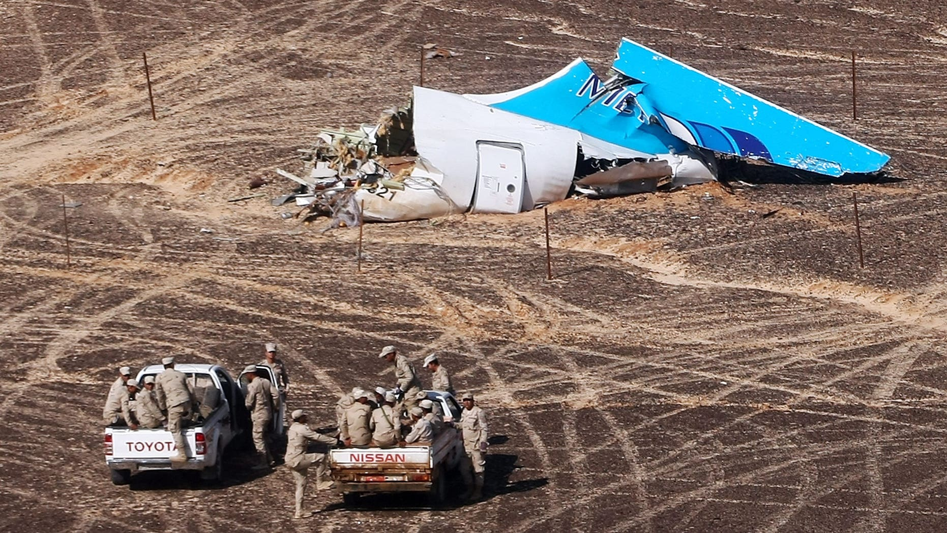 Nov. 2, 2015- Egyptian military vehicles approach a plane's tail at the wreckage of a passenger jet bound for St. Petersburg in Russia that crashed in Hassana, Egypt on  Nov. 1, 2015. (Maxim Grigoriev/Russian Ministry for Emergency Situations via AP)