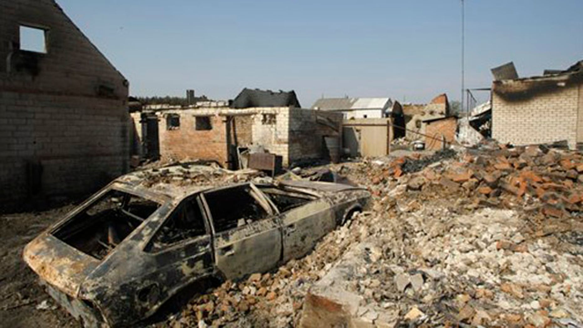 A charred car stands in the village Shuberskoe destroyed by a forest fire near the town of Voronezh, some 500 km (294 miles) south of Moscow, Russia, Monday, Aug. 2, 2010. At least 34 people have died in wildfires that have destroyed hundreds of homes and burned through vast spans of tinder-dry land, but firefighters are making headway and the blazes are dying down.