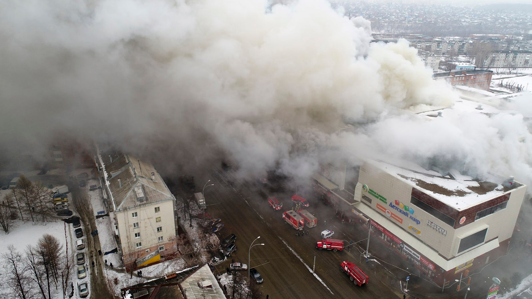 In this Russian Emergency Situations Ministry photo, on Sunday, March 25, 2018, smoke rises above a multi-story shopping center in the Siberian city of Kemerovo.