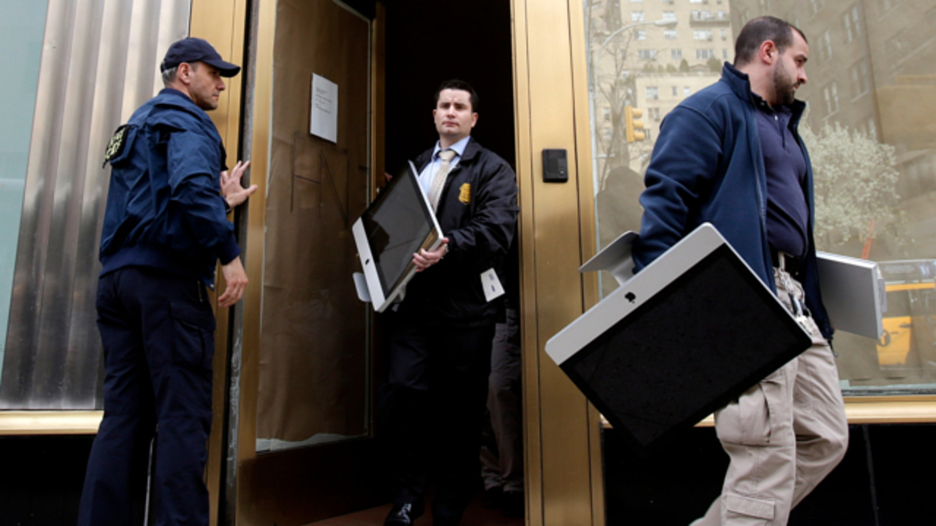 April 16, 2013: Federal agents remove items, including computers, from an art gallery in New York.