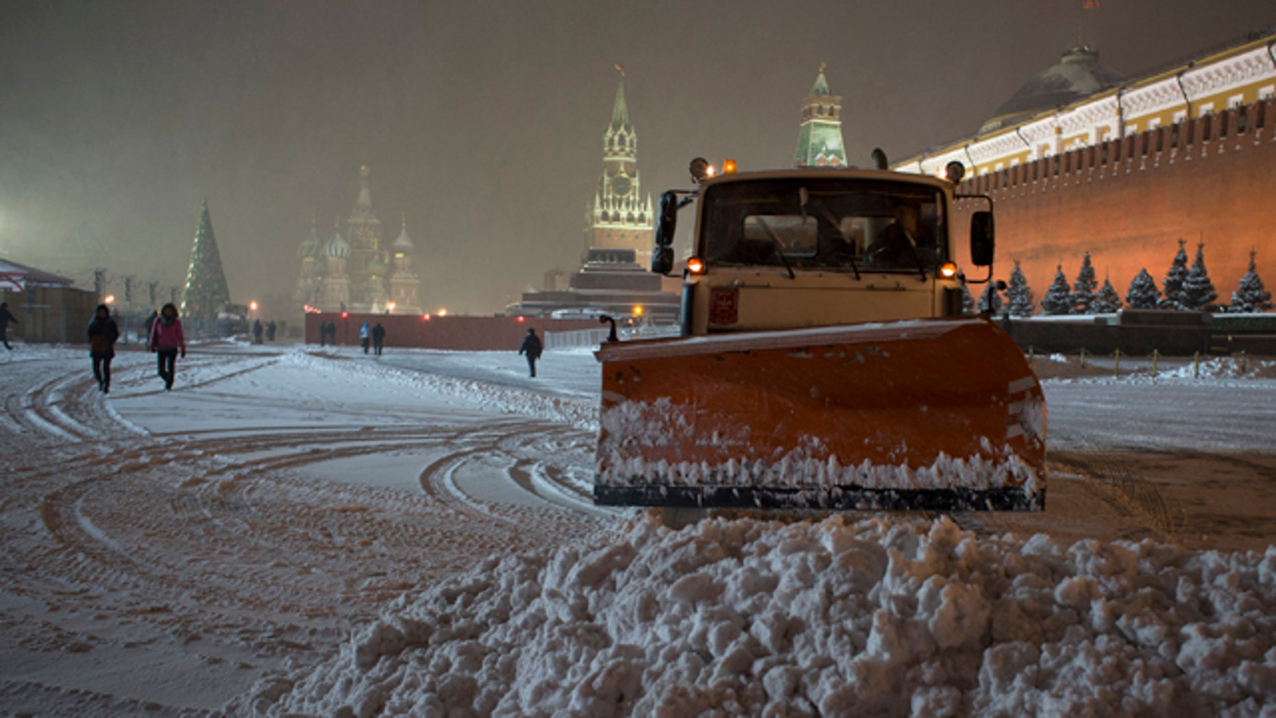 Nov. 29, 2012: A bulldozer removes snow in Red Square in Moscow, Russia.