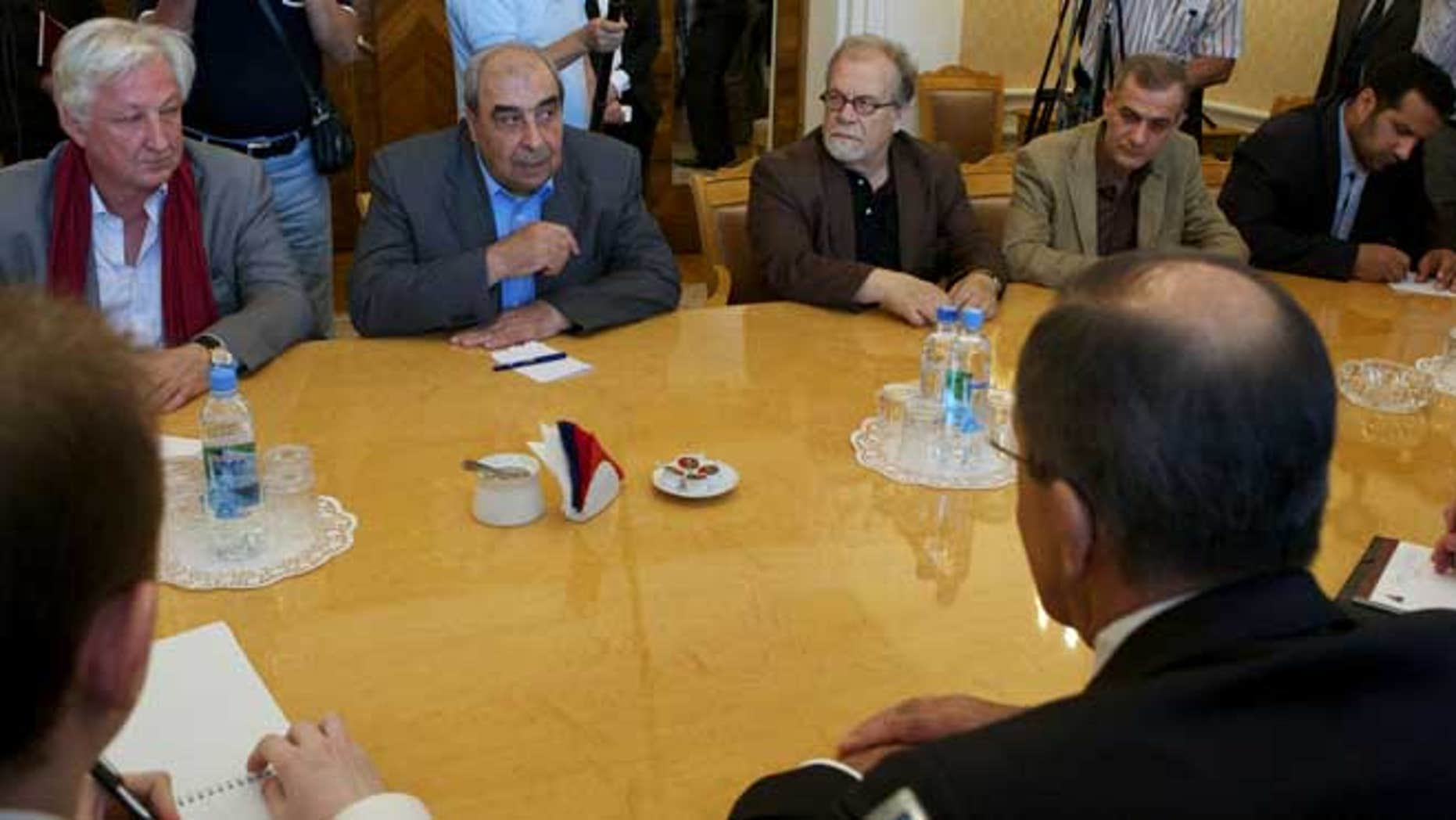July 9, 2012: Michel Kilo, a Syrian opposition leader and writer, second left, and other unidentified members of a delegation meet with Russian Foreign minister Sergey Lavrov, foreground right, in Moscow, Russia.
