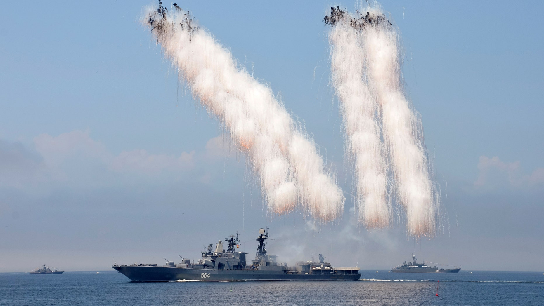 File photo - Russian warships sail past exploding anti-missile ordnance during a rehearsal for the Navy Day parade in the far eastern port of Vladivostok, Russia, July 30, 2016. (REUTERS/Yuri Maltsev)