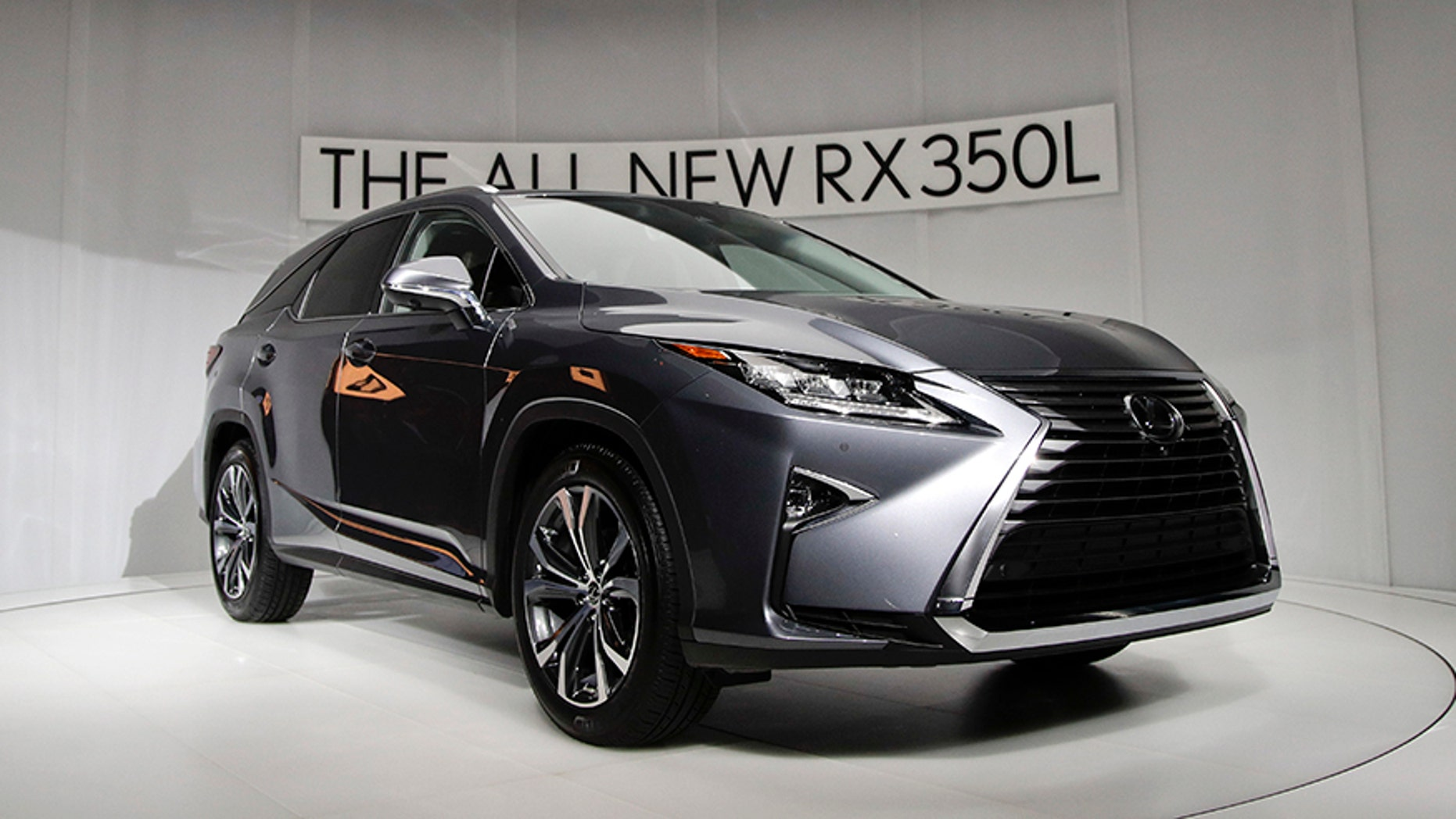 The 2018 Lexus RX 350L is unveiled at the Los Angeles Auto Show, Wednesday, Nov. 29, 2017, in Los Angeles. (AP Photo/Jae C. Hong)