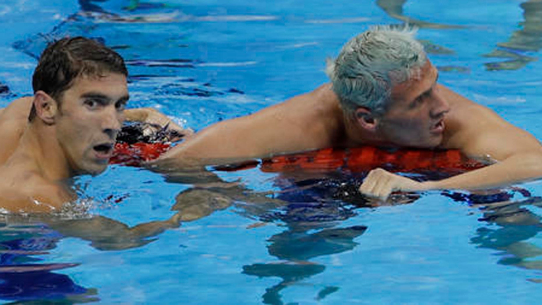 United States' Michael Phelps wins the gold medal in the men's 200-meter individual medley ahead of fifth placed United States' Ryan Lochte, right, during the swimming competitions at the 2016 Summer Olympics, Thursday, Aug. 11, 2016, in Rio de Janeiro, Brazil. (AP Photo/Natacha Pisarenko)